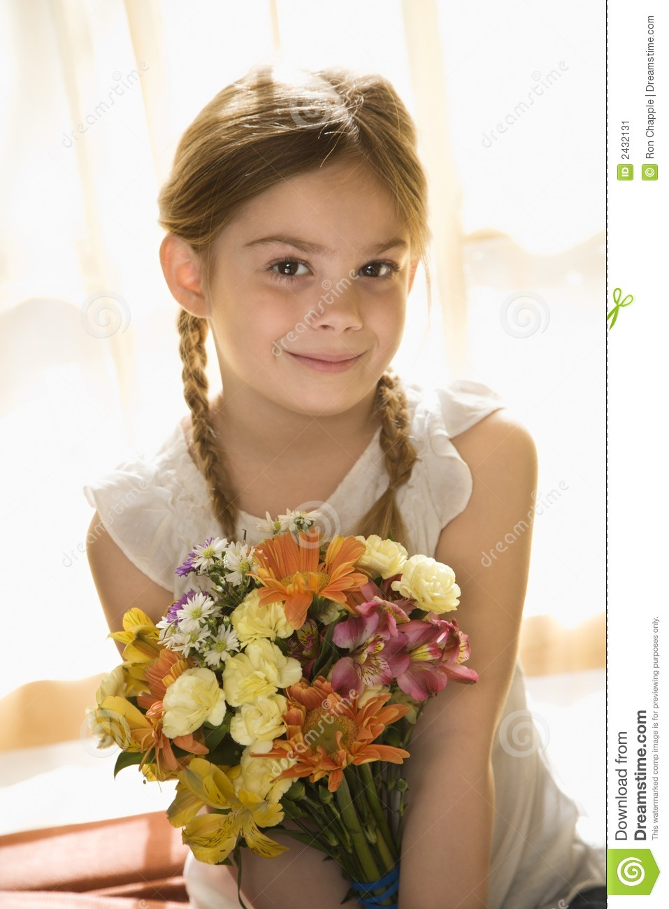 Girl Holding Flowers. Stock Image - Image: 2432131