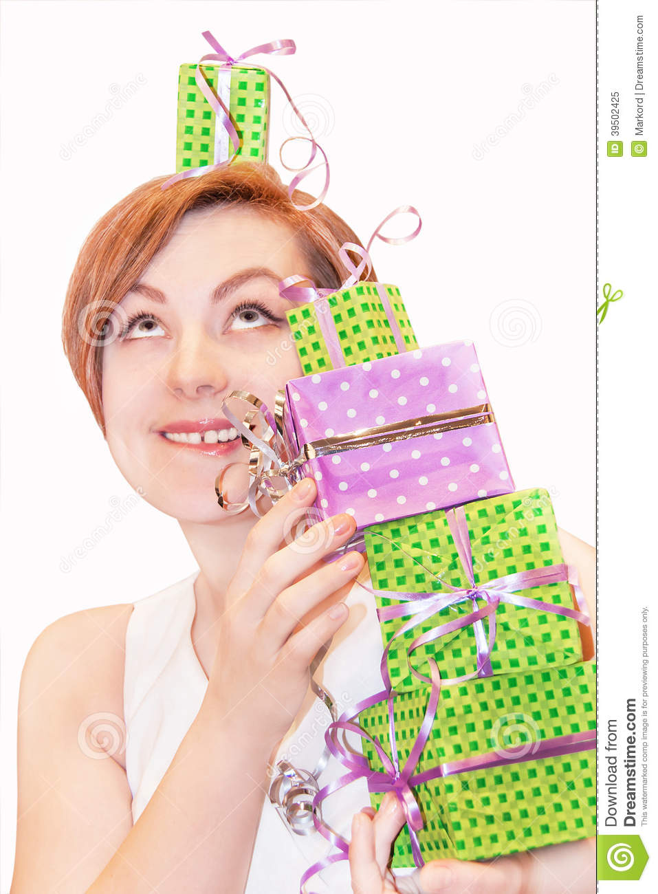 Girl holding gift boxes.