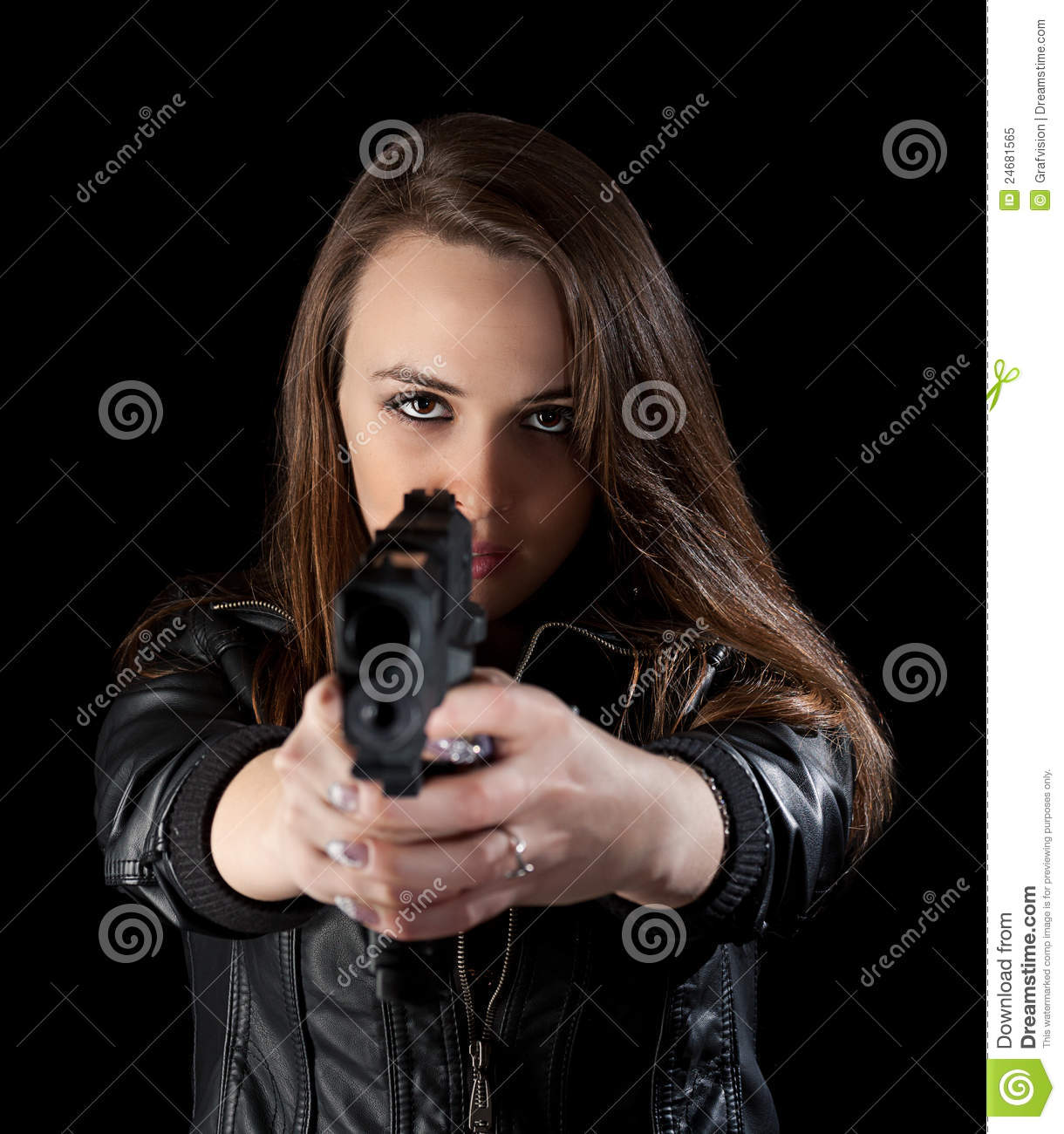 Shot of a beautiful girl holding gun, isolated on black background.