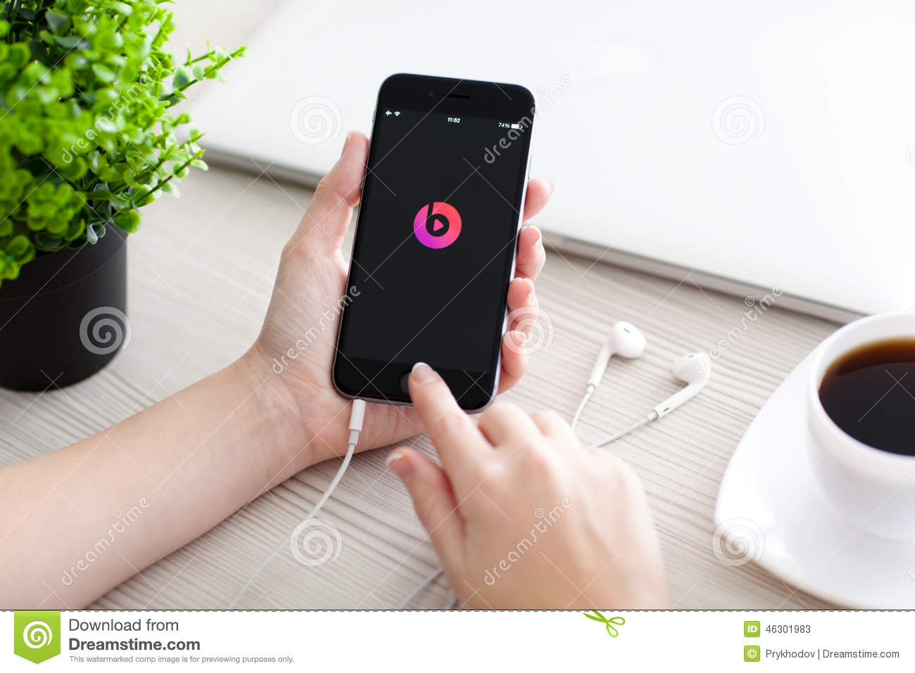 Girl holding iPhone 6 Space Gray with service Beats Music