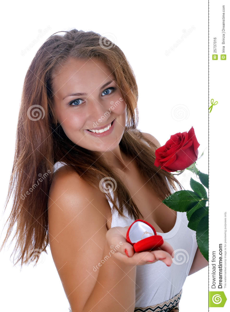 Girl holding jewellery gift box and flower.
