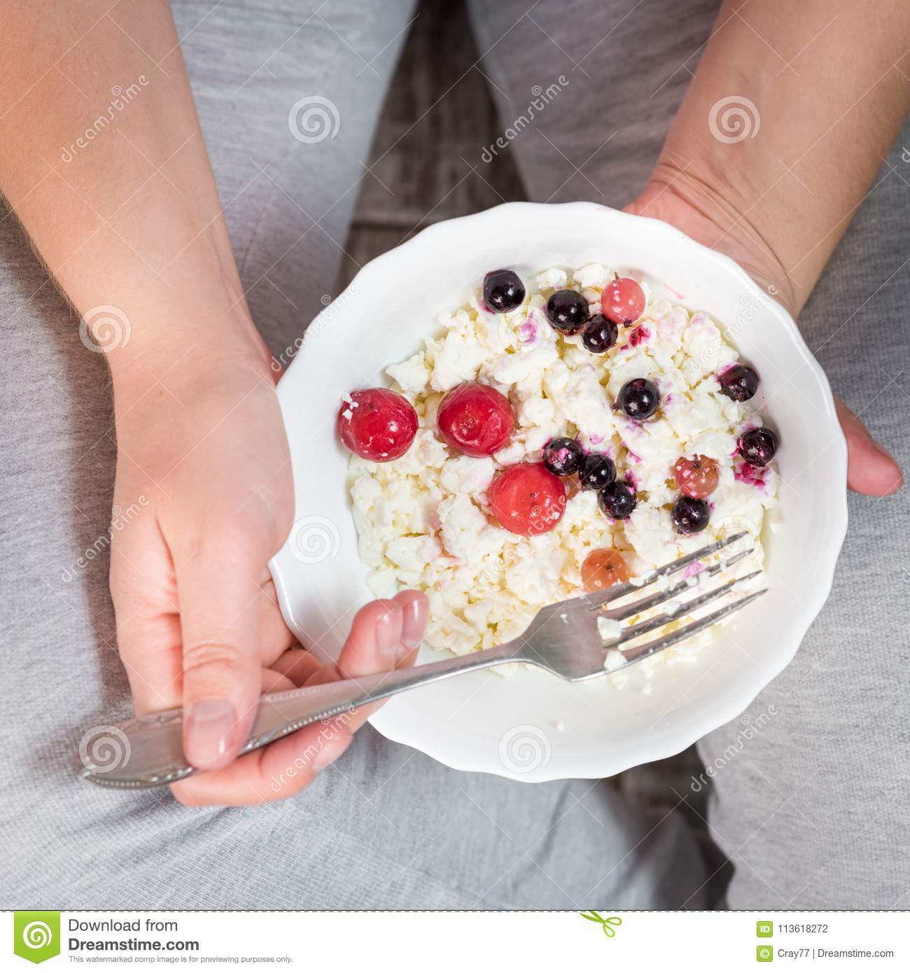 Brilliant The Girl Is Holding A Plate Of Cottage Cheese Stock Photo Download Free Architecture Designs Rallybritishbridgeorg