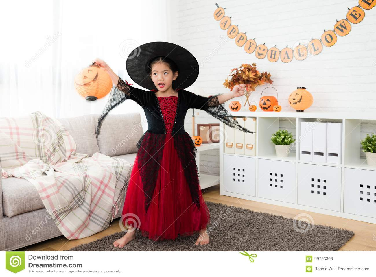 girl holding pumpkin lantern play alone stock photo - image of home