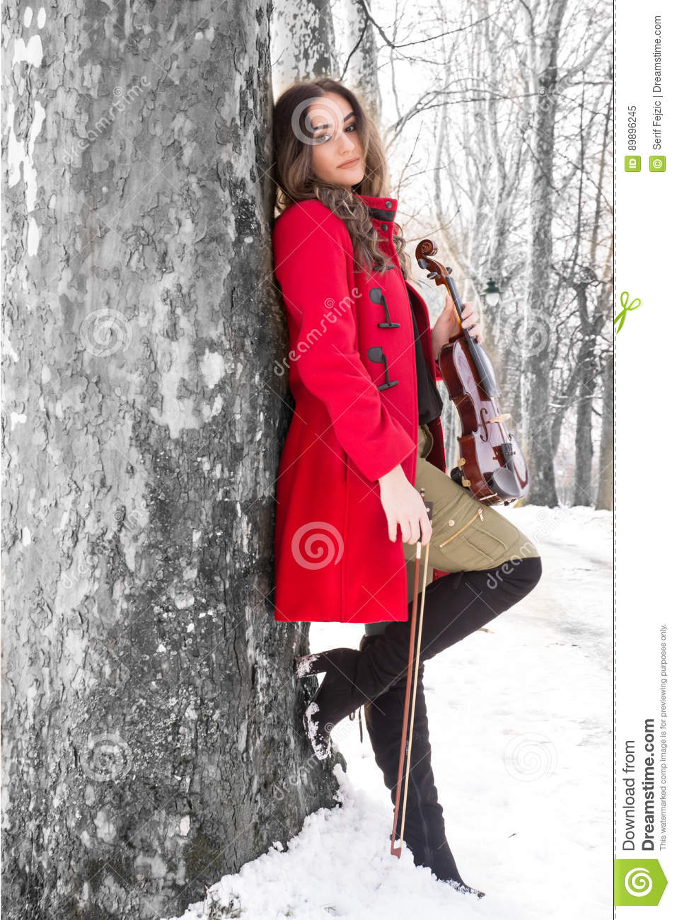 Girl holding violine in hands