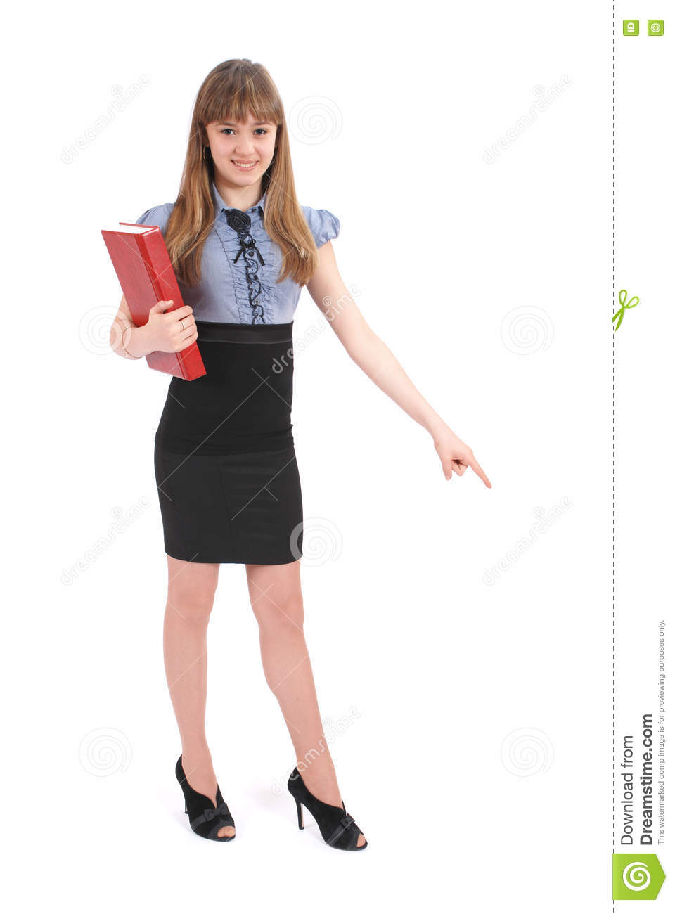 Girl holds the red book. Also specifies hand a direction