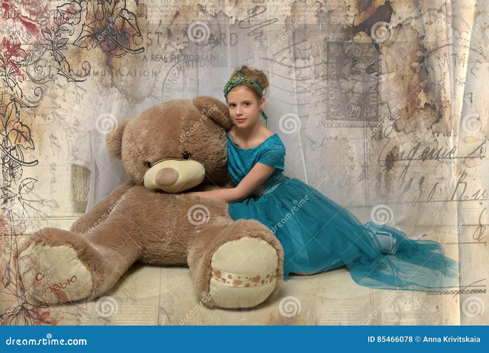 Girl with huge teddybear
