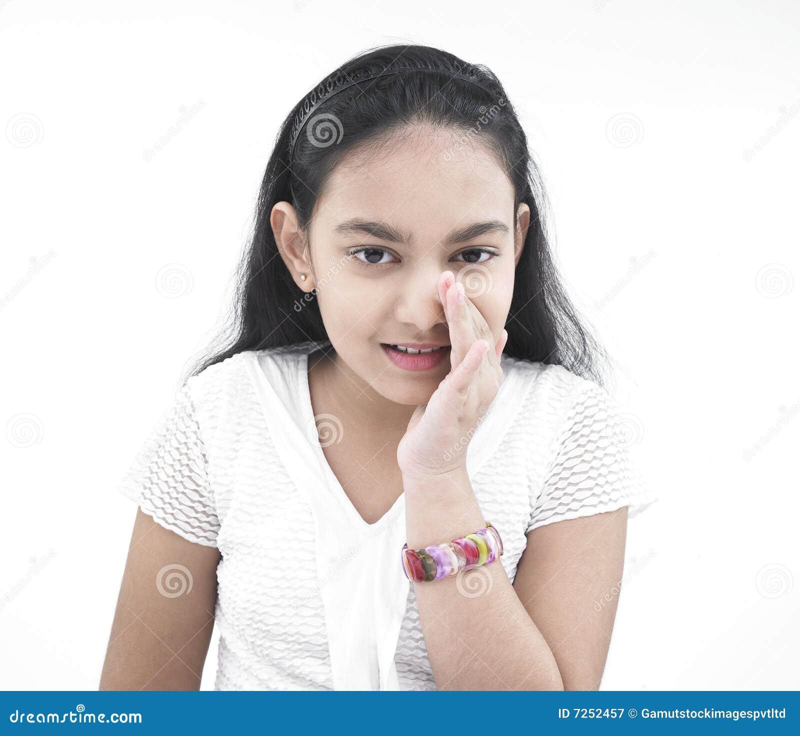 Girl Of Indian Origin Whispering Royalty Free Stock