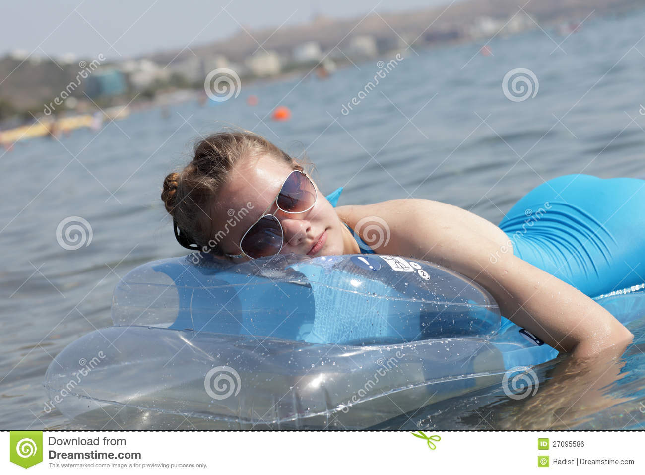 Girl On Inflatable Mattress Royalty Free Stock Image - Image: 27095586