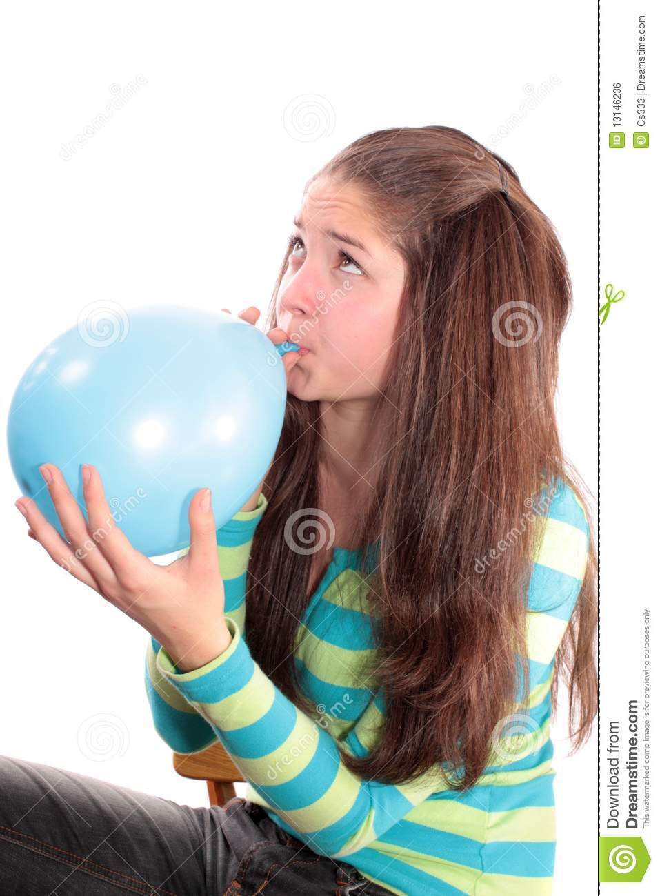 Woman inflates a balloon and sits on it