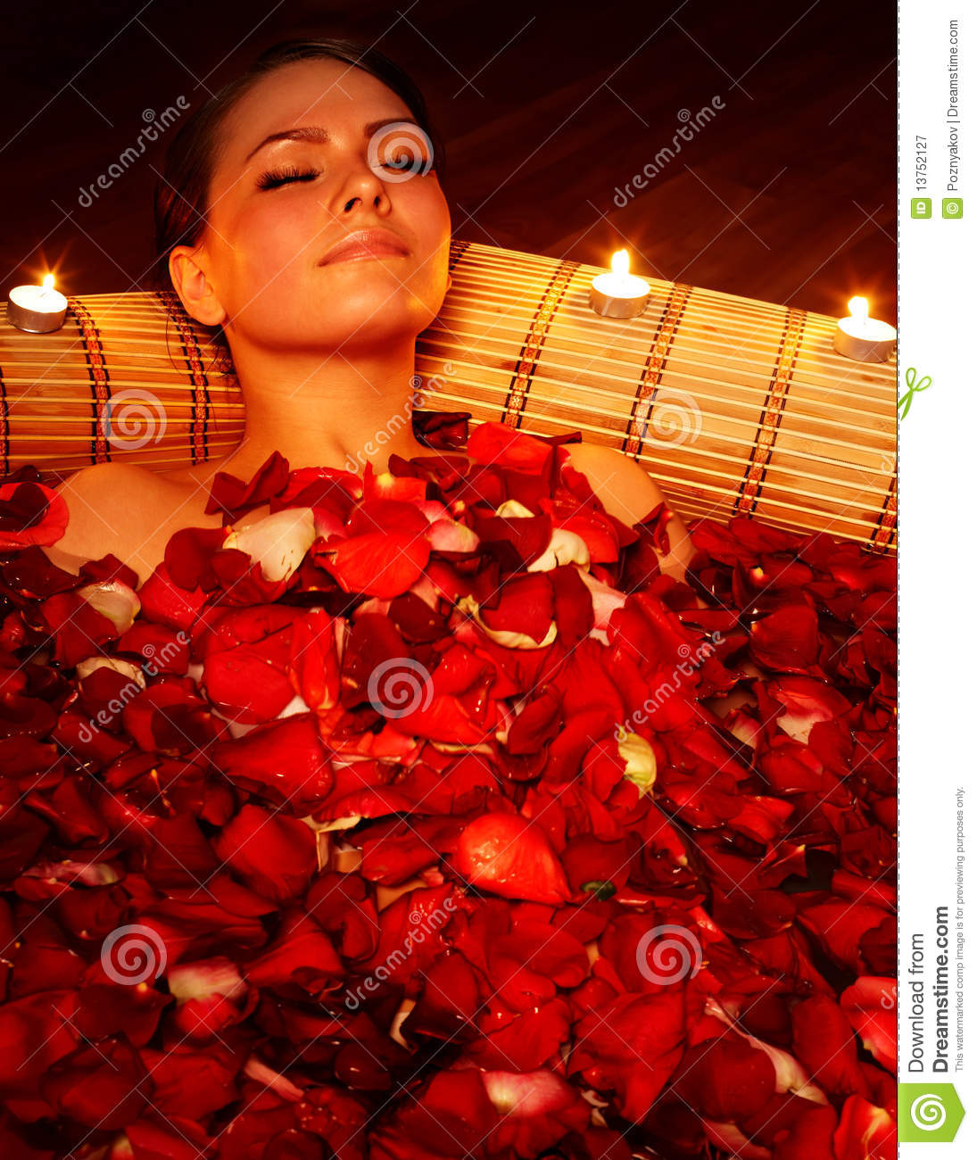 Girl In Jacuzzi With Rose Petal And Candle Royalty Free