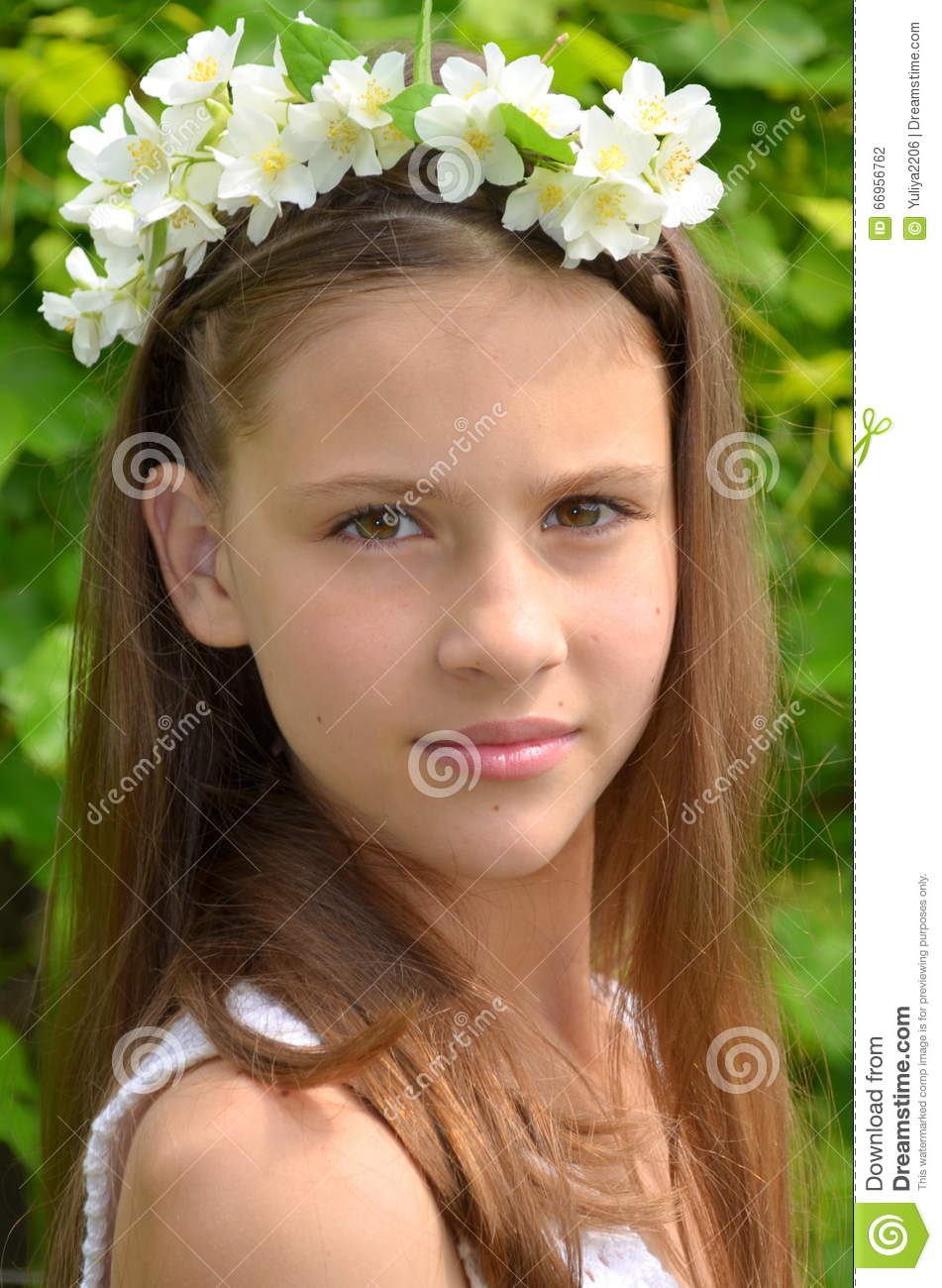 Girl with jasmine flowers stock photo image of femininity 66956762 girl with a flower wreath on head with live jasmine flowers izmirmasajfo