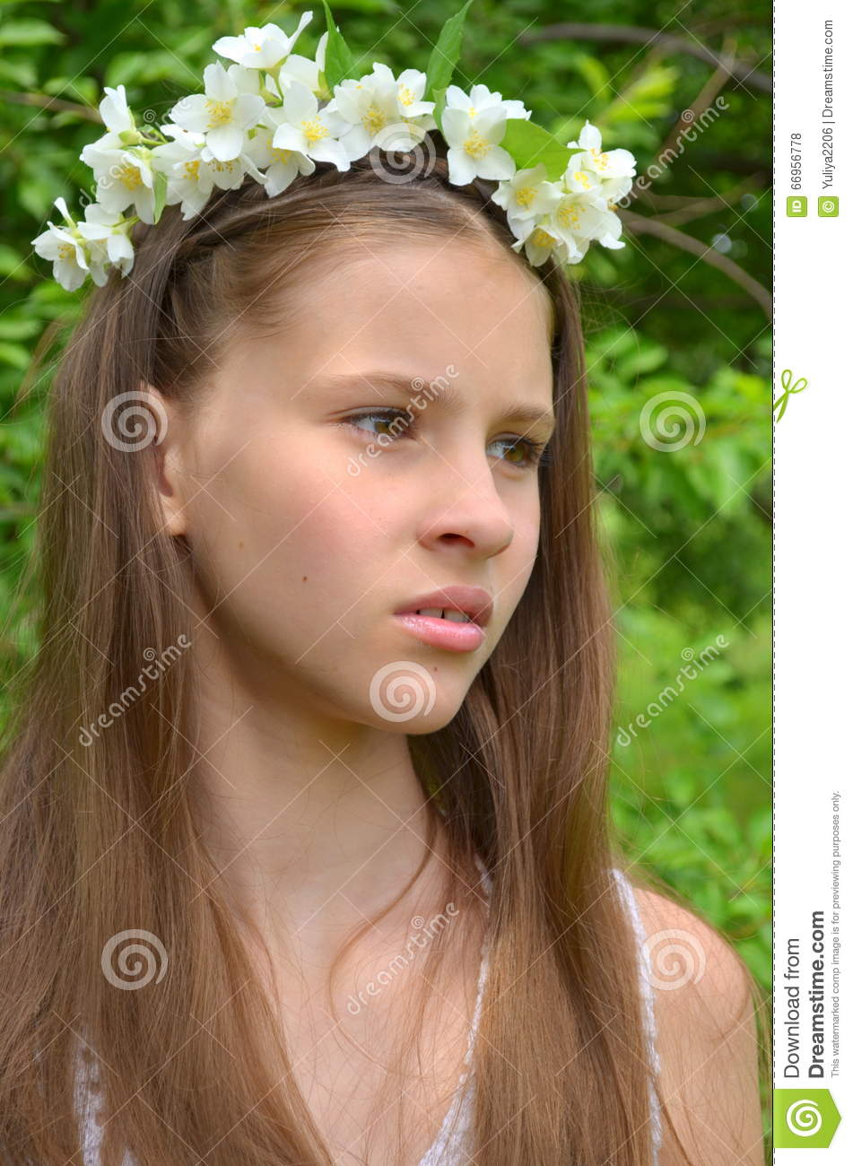 Girl with jasmine flowers stock photo image of braids 66956778 girl with a flower wreath on head with live jasmine flowers izmirmasajfo