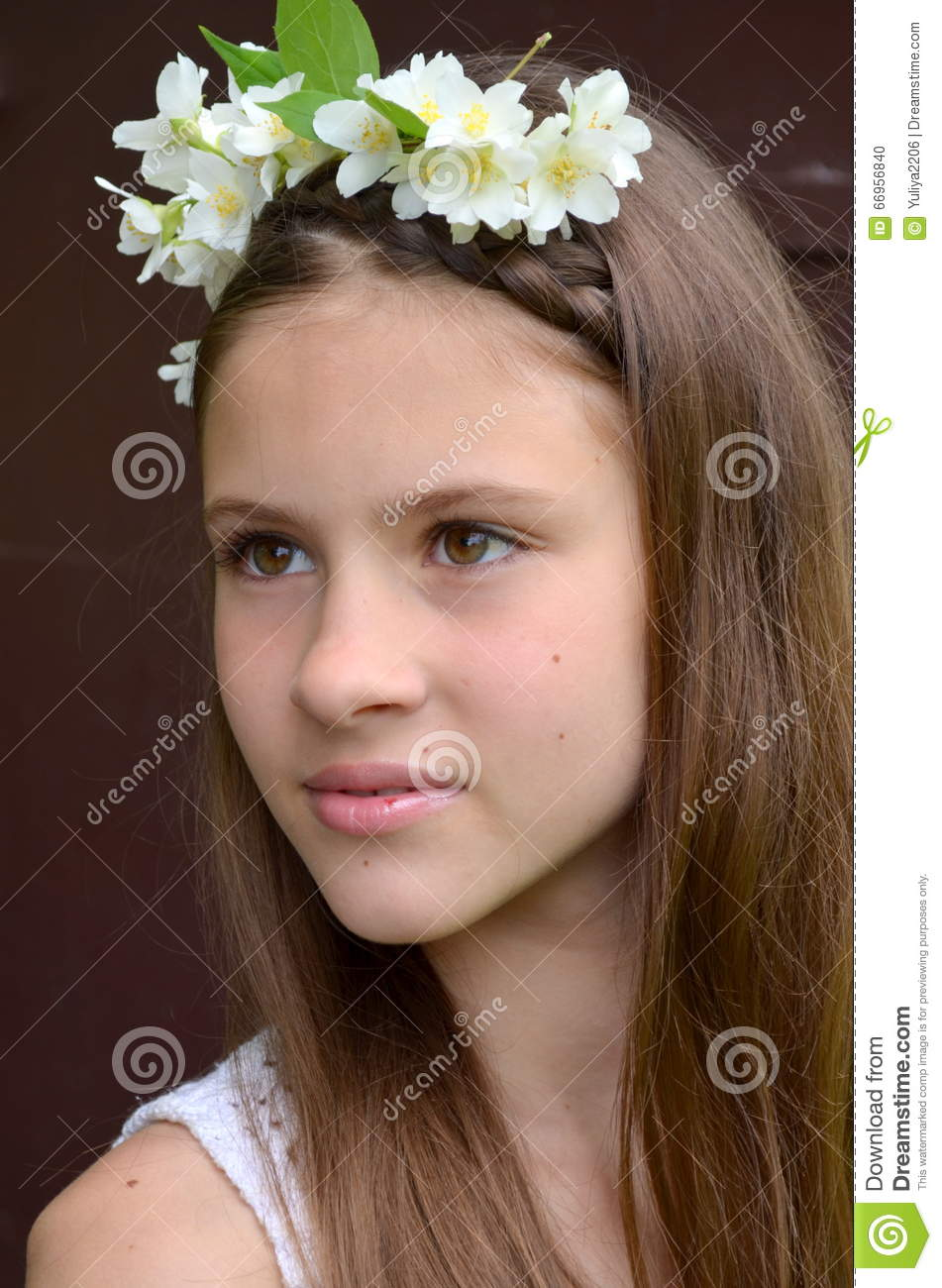 Girl with jasmine flowers stock photo image of caucasian 66956840 girl with a flower wreath on head with live jasmine flowers izmirmasajfo