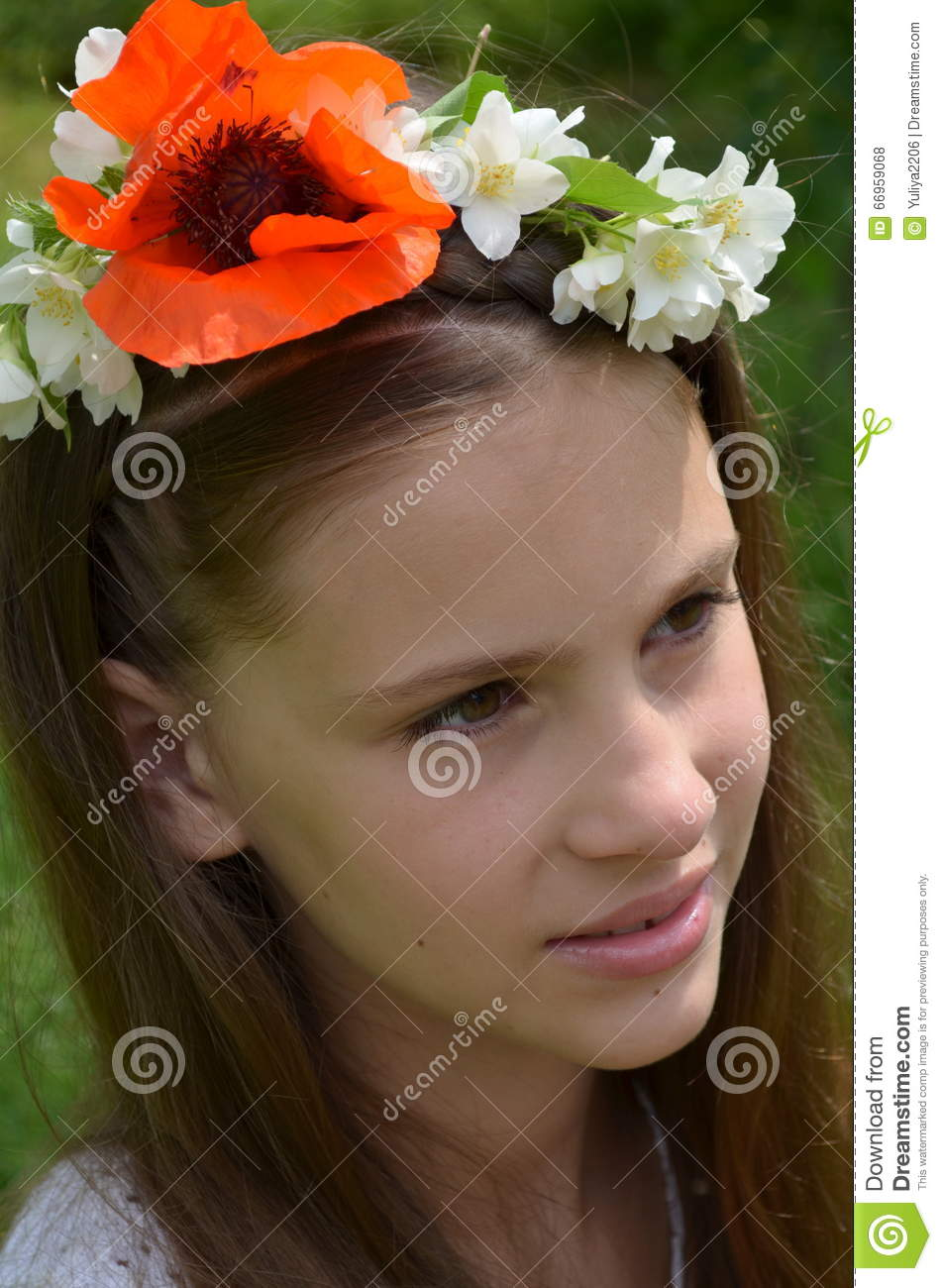 Girl with jasmine flowers and poppies stock photo image of field girl with a flower wreath on head with live jasmine flowers and poppies izmirmasajfo