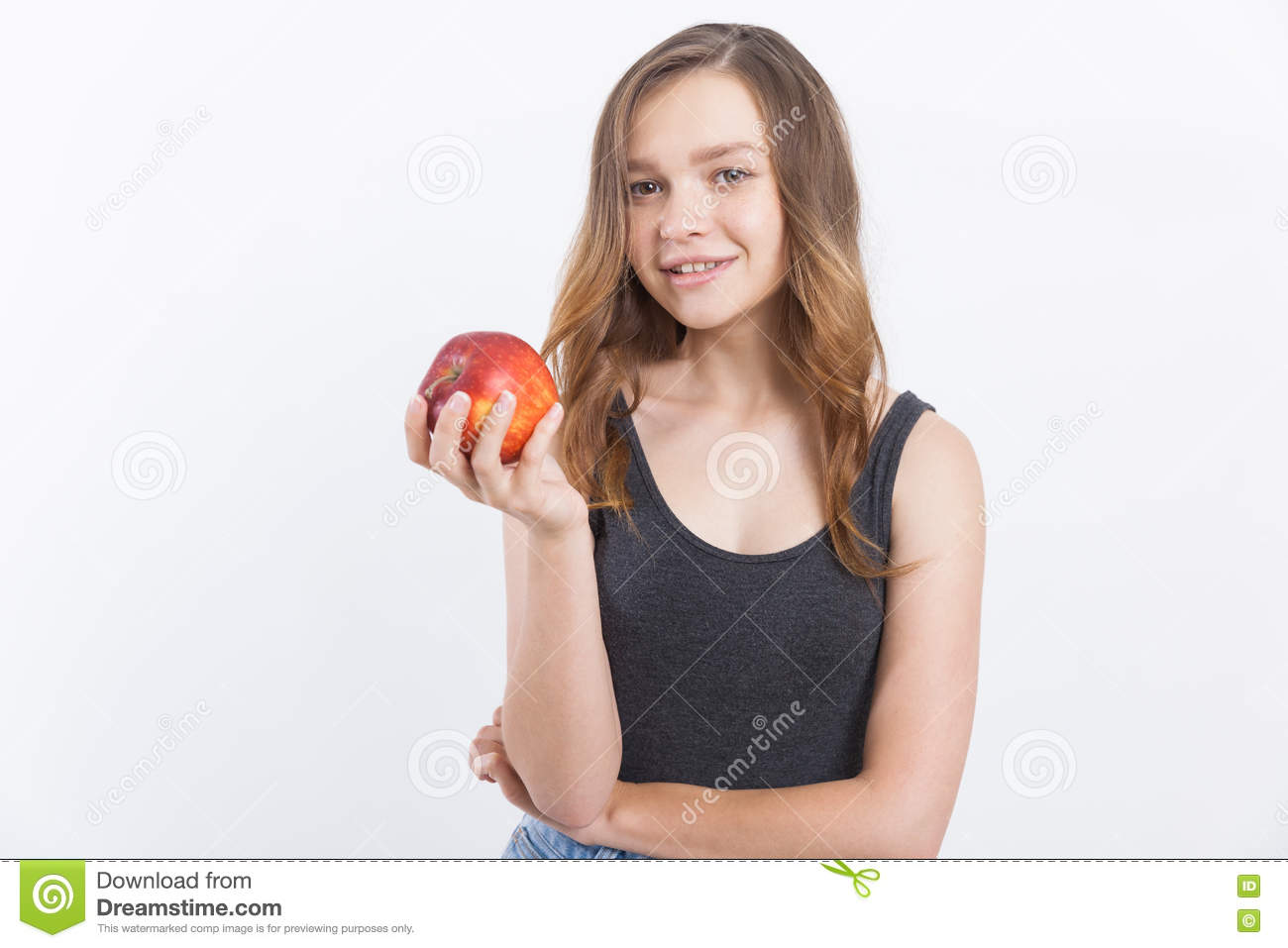Girl In Jeans With Red Apple Stock Photo - Image: 75064850