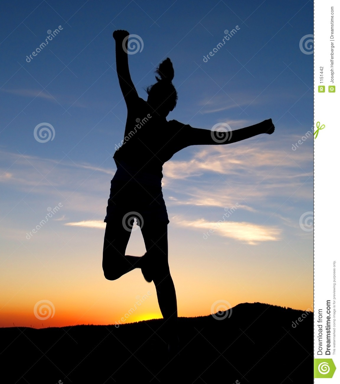 happy girl runs and jumps in the air against the sunset.