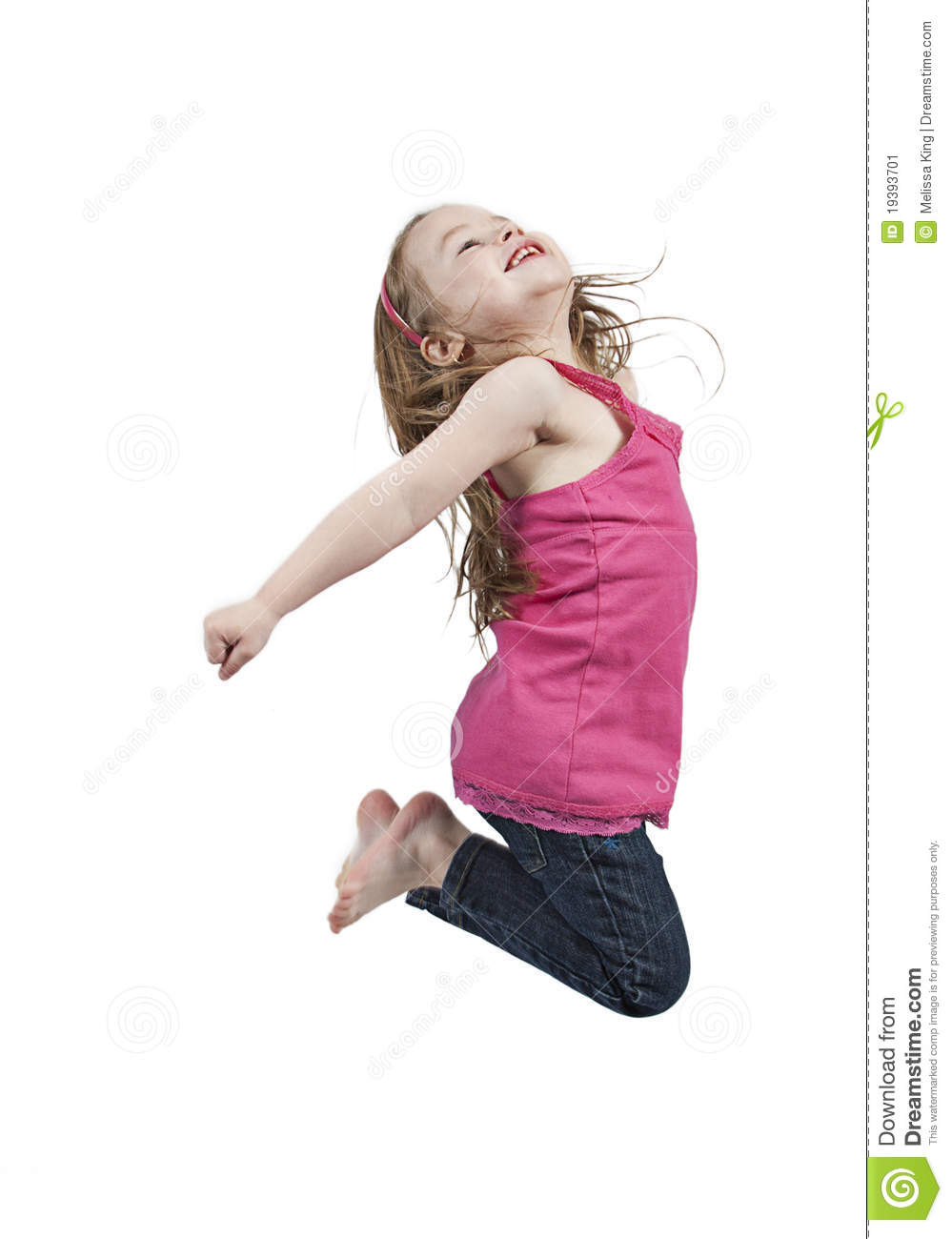 Cute young girl jumping in air white studio background