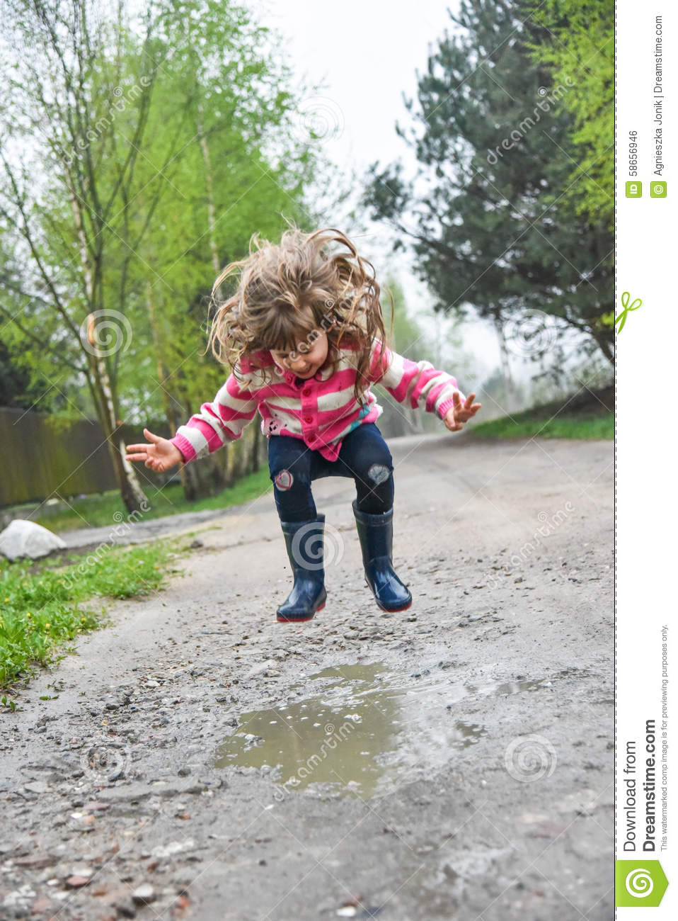 Girl jumping in a paddle