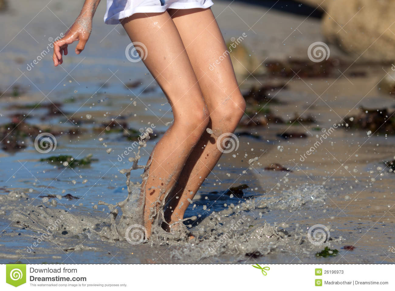 Girl jumps in muddy water