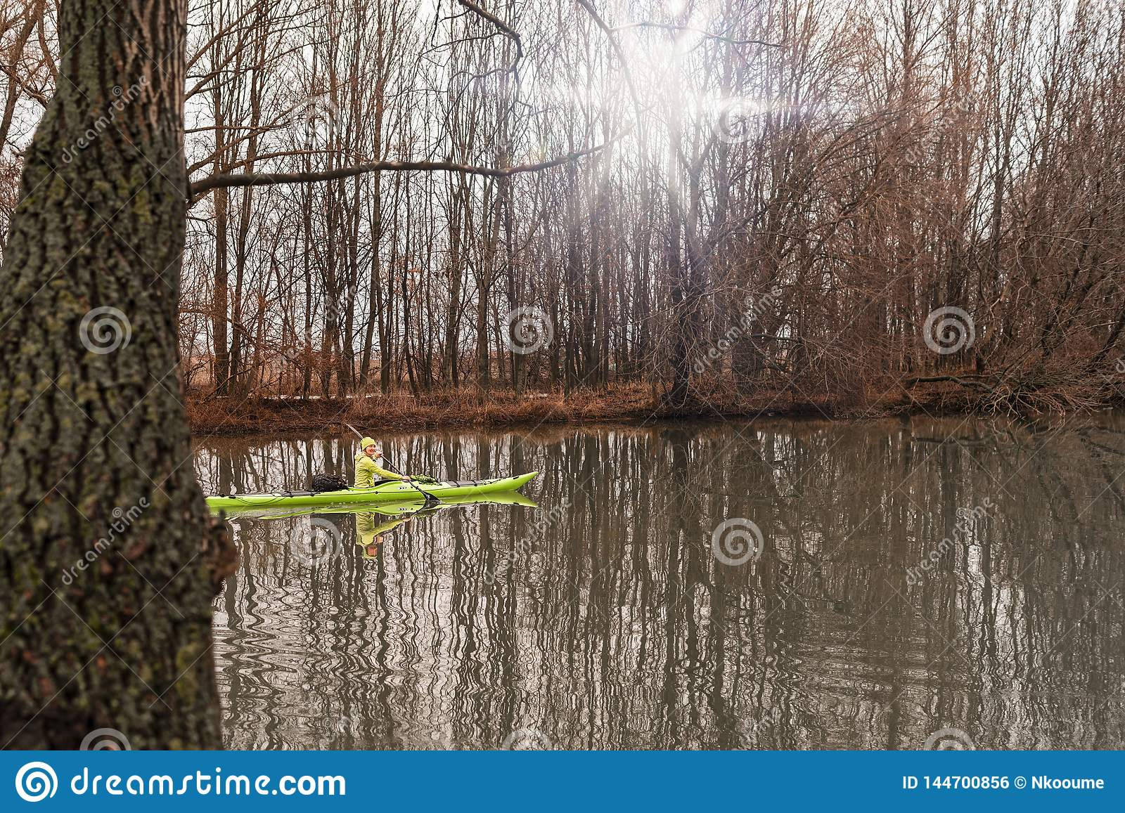 A girl on a kayak.The girl floats on the river in a kayak.