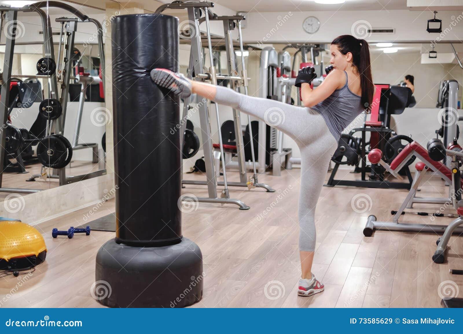 Girl kicking bag