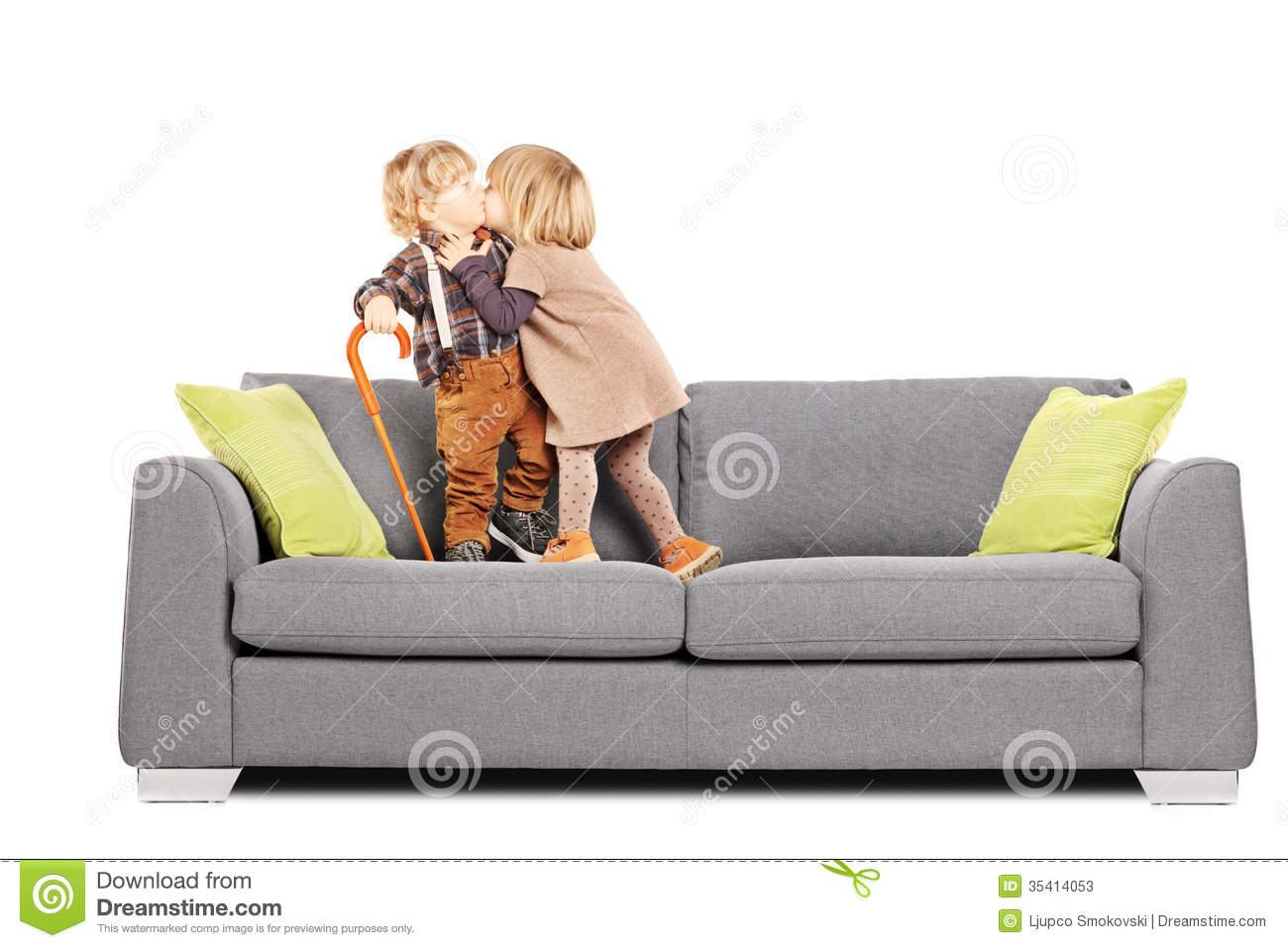 girl kissing a boy while standing on a sofa stock photos image 35414053. Black Bedroom Furniture Sets. Home Design Ideas