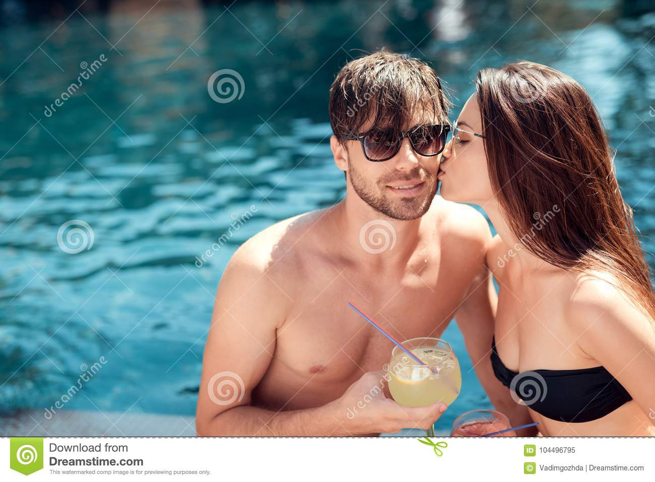 TINA: Girls kissing nice in the pool