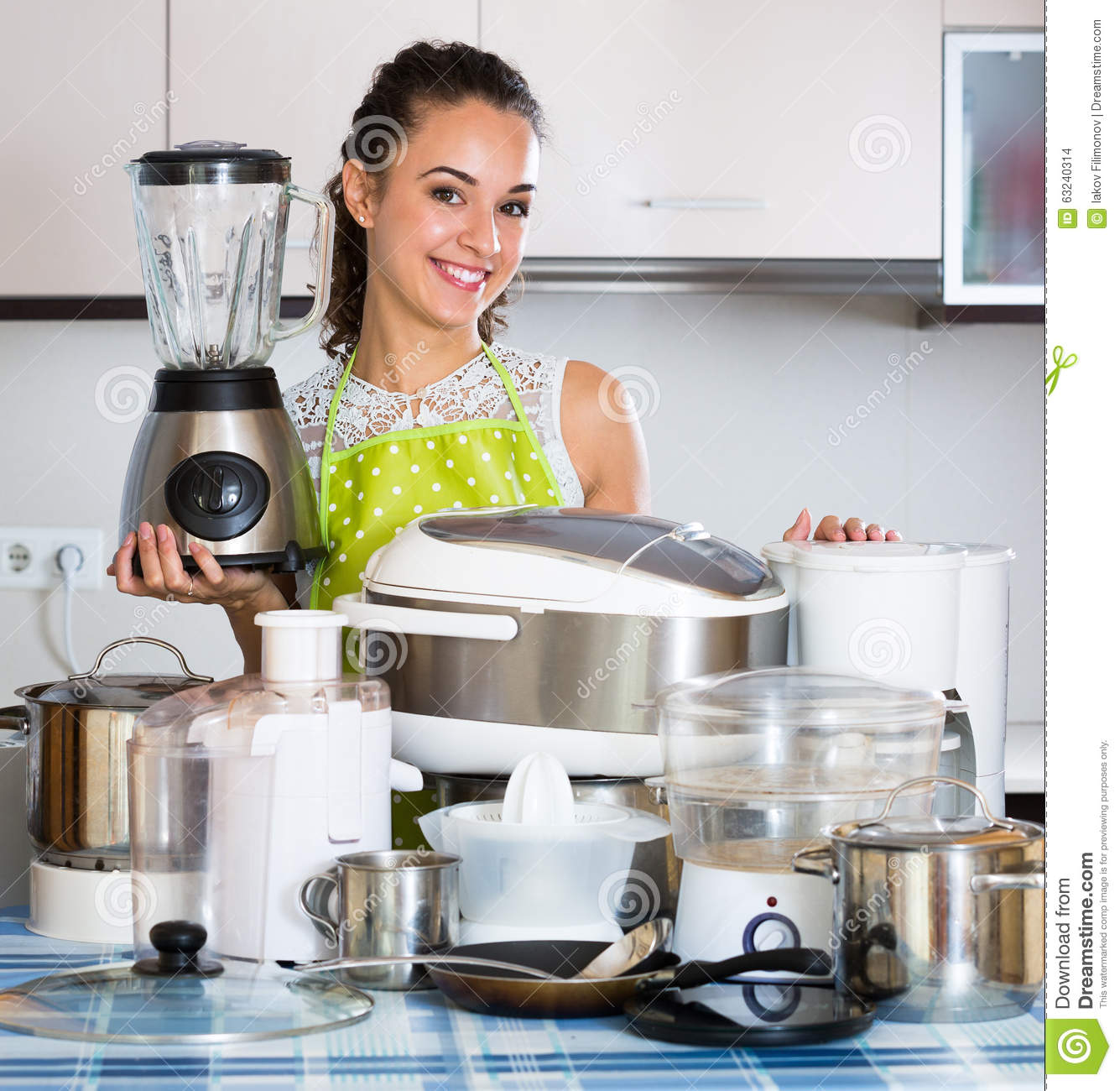 Happy Girl Kitchen: Girl With Kitchen Appliances At Home Stock Photo