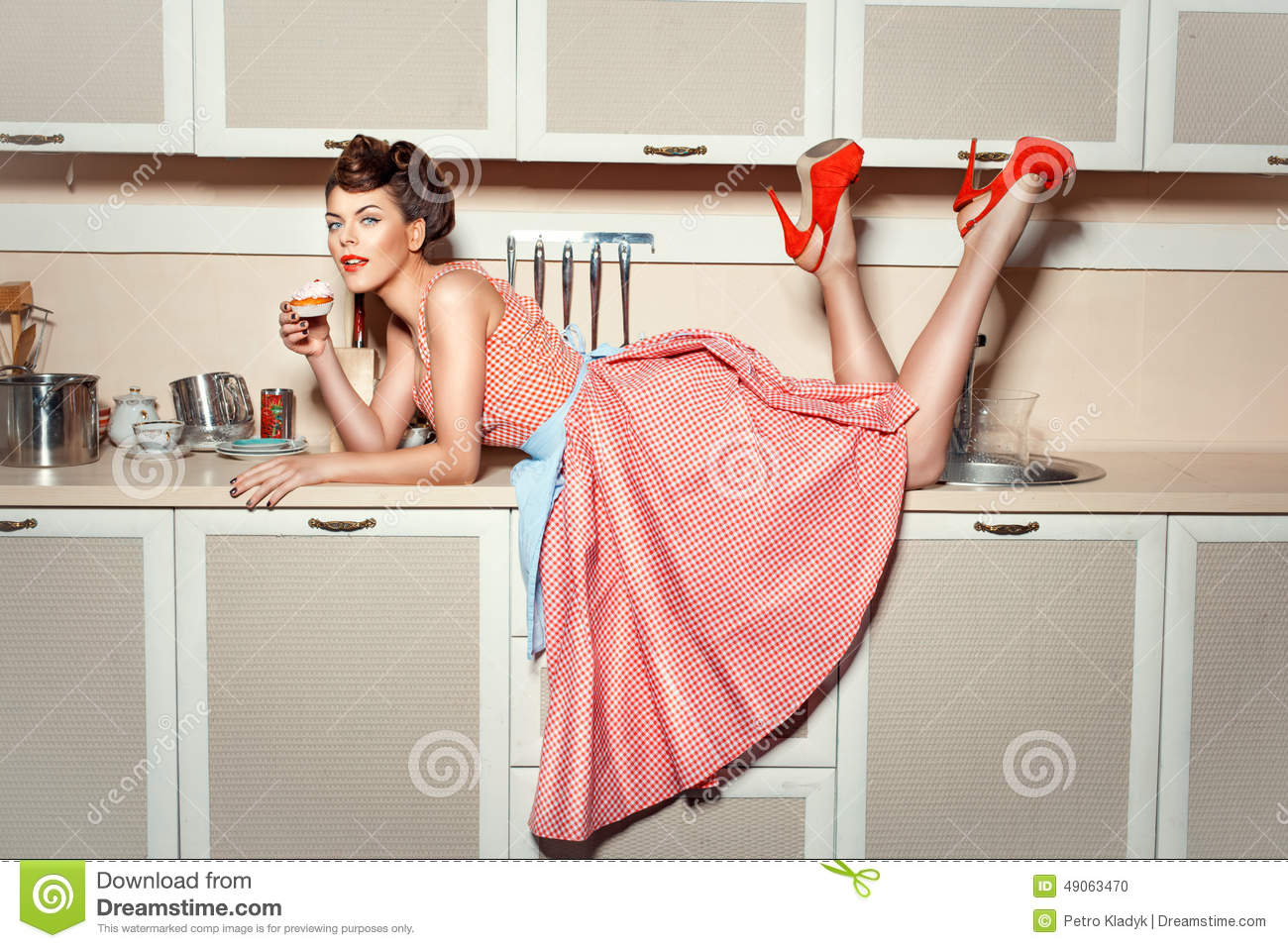 The Girl On The Kitchen Table. Stock Photo - Image: 49063470