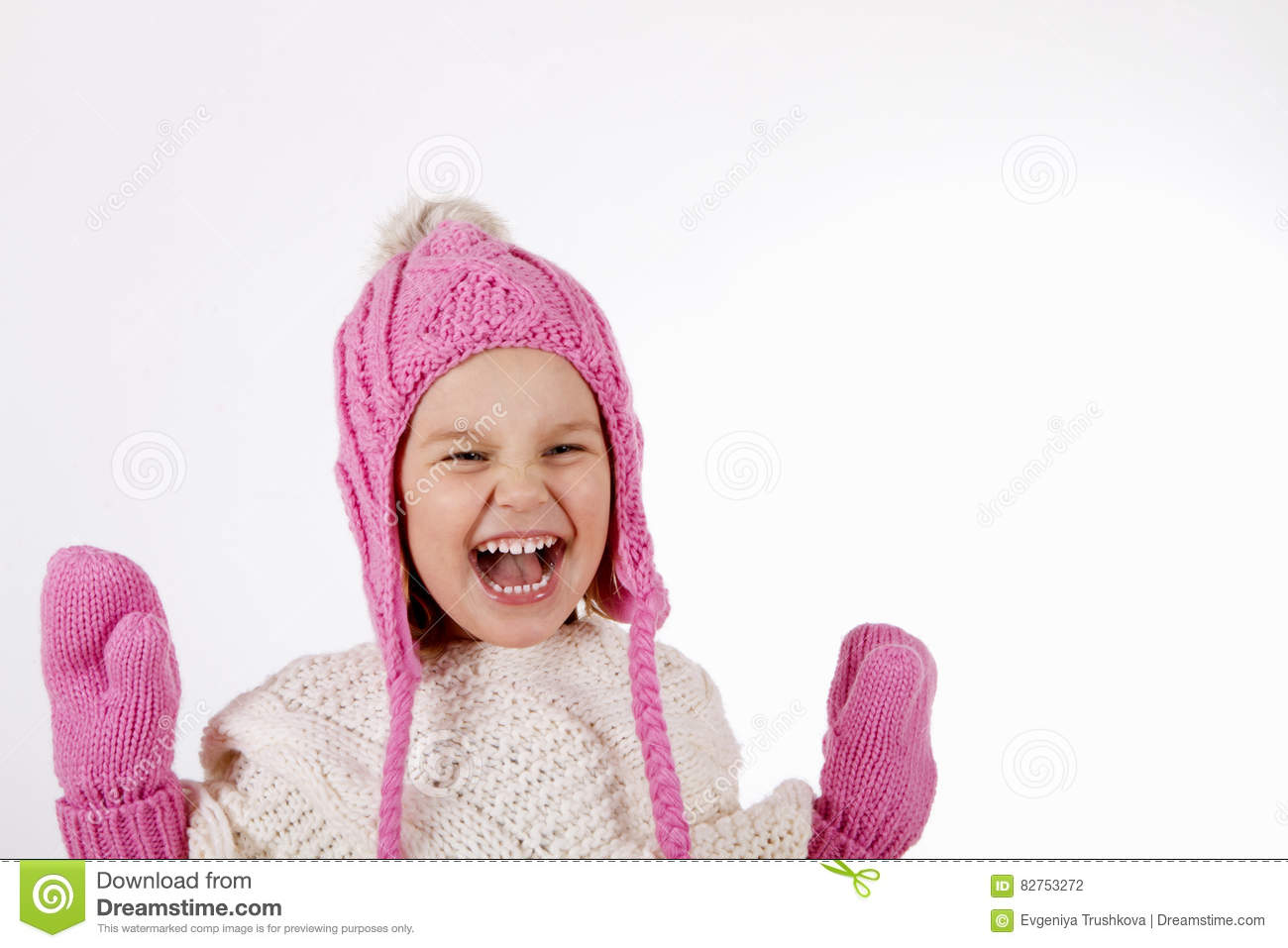 Girl in a knitted hat and mittens.
