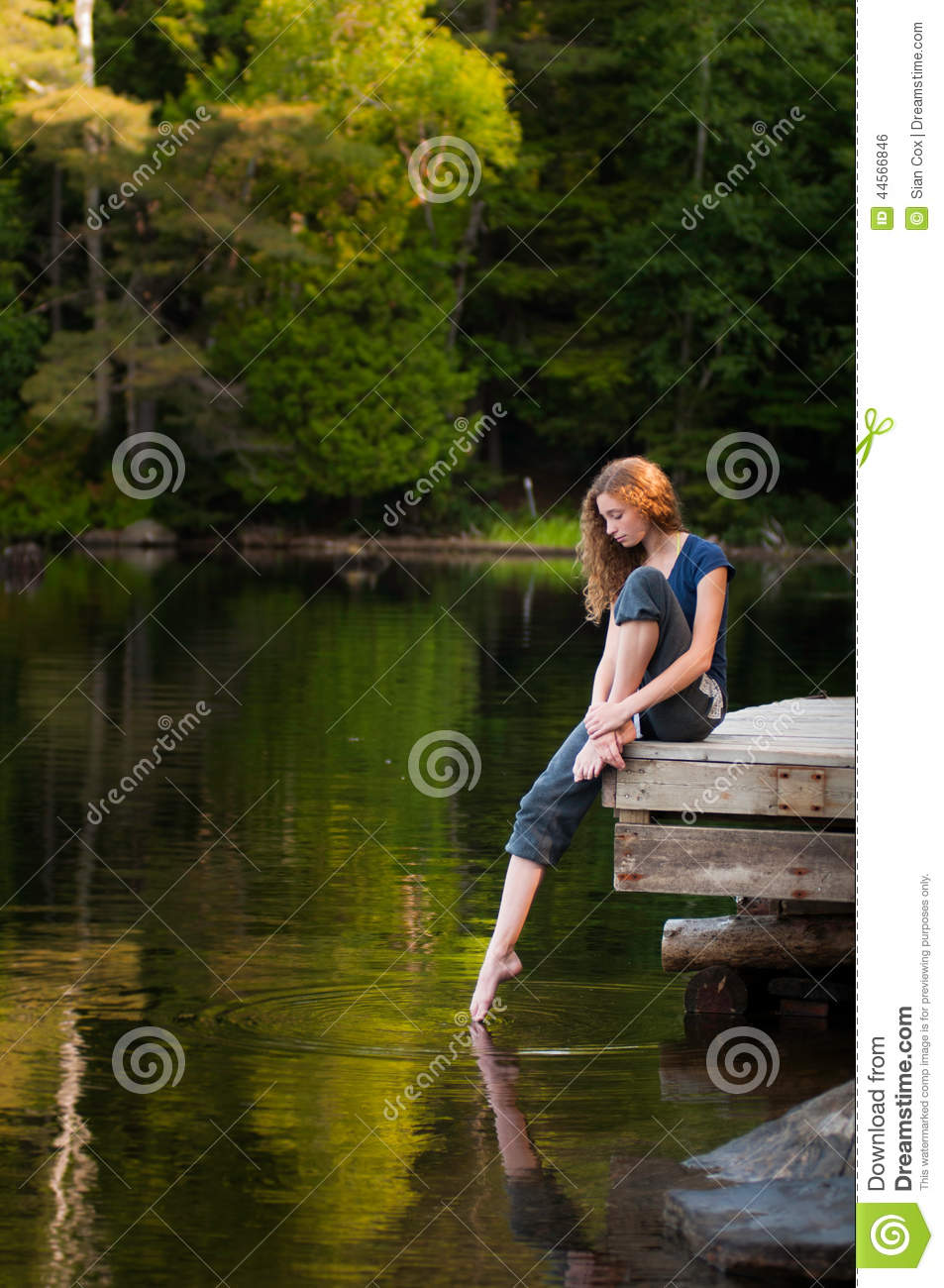 Girl sitting alone on dock by lake royalty free stock - Cartoon girl sitting alone ...