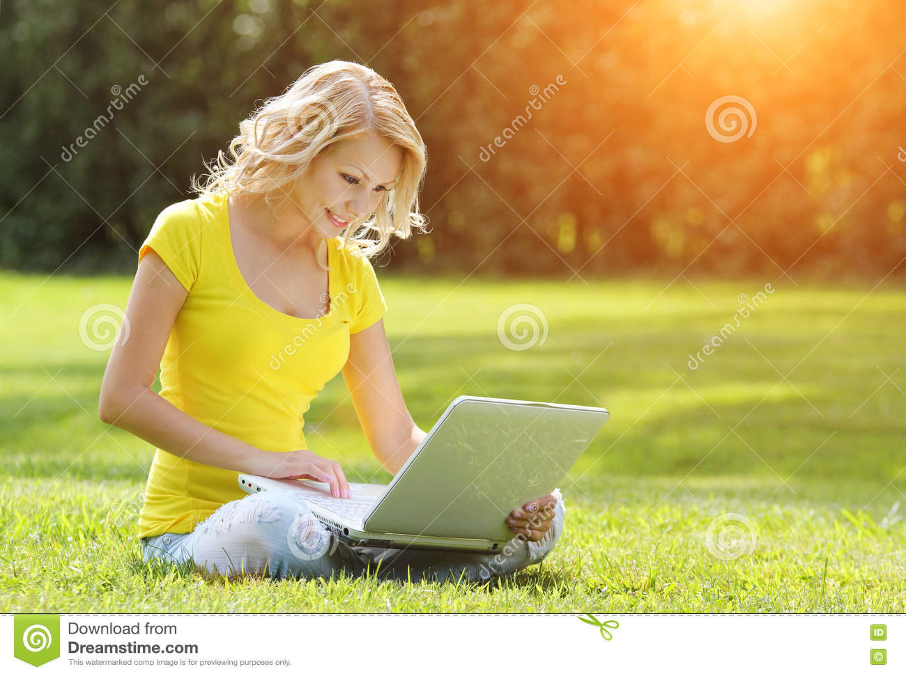 Girl with laptop. Blonde beautiful young woman with notebook
