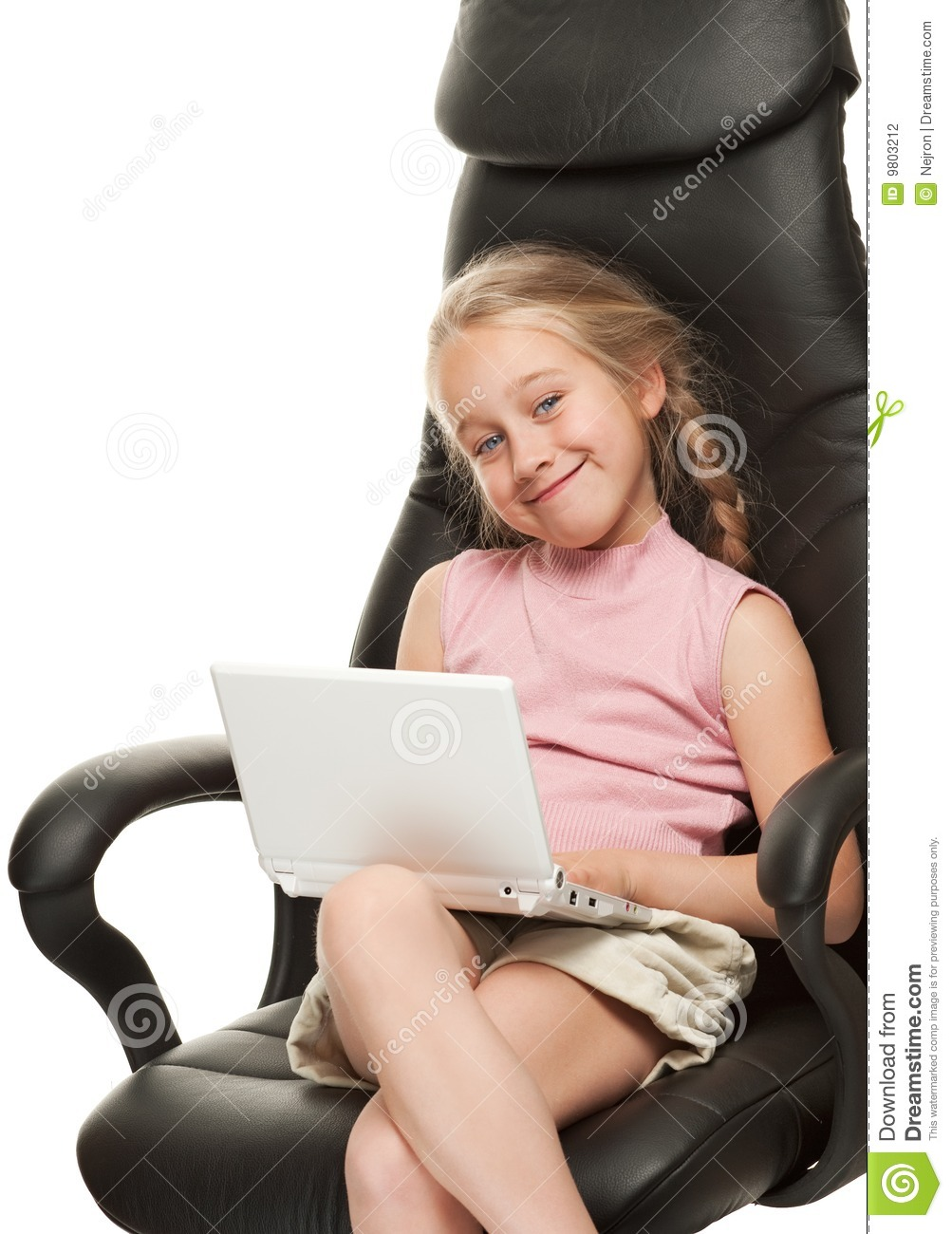 girl with laptop sitting on a chair stock photography