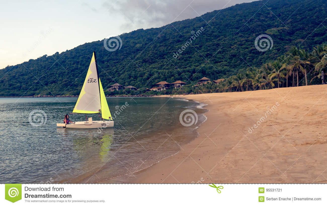 Girl on a Laser sailboat