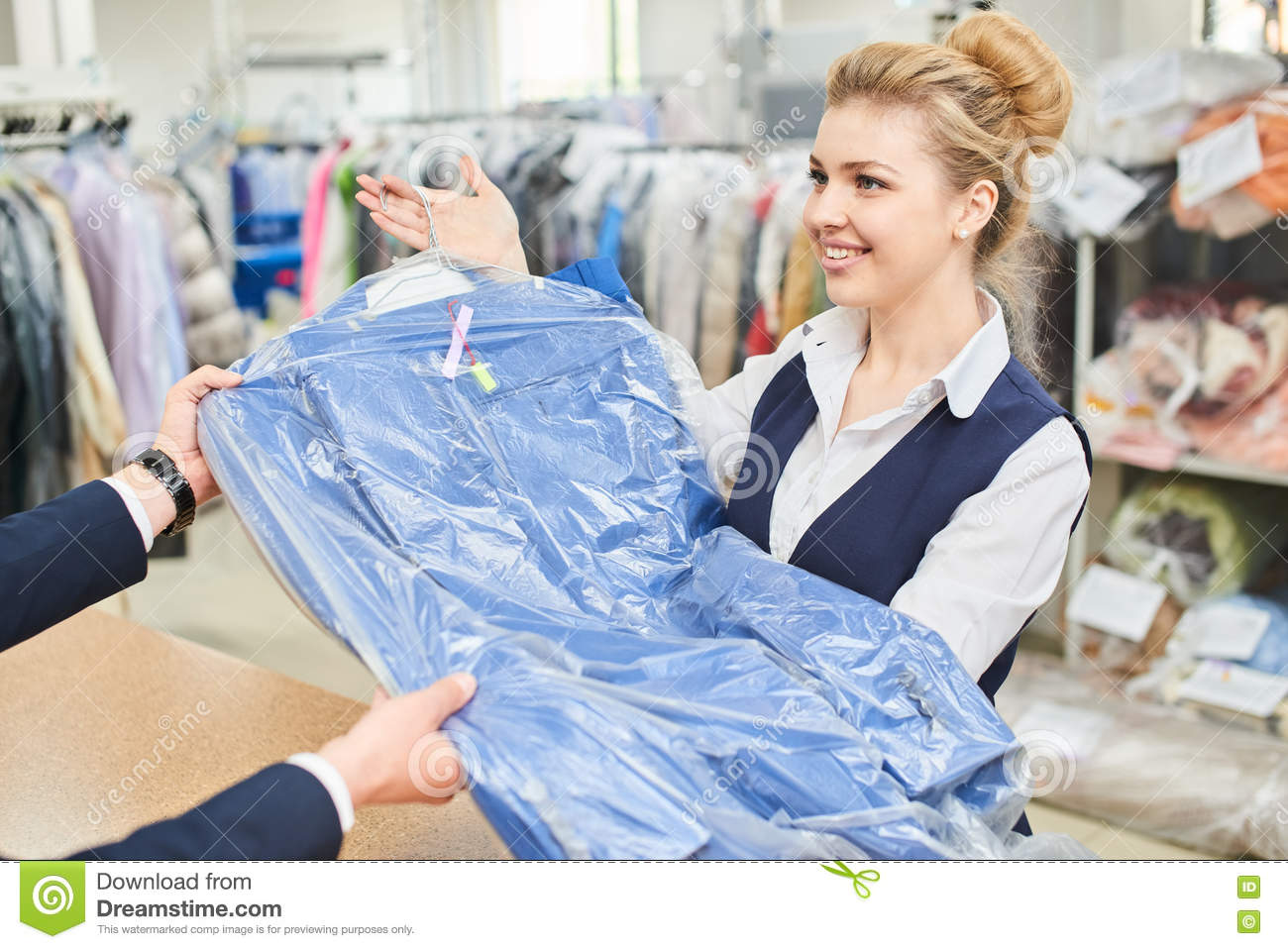 The Laundry Worker Performs Repair Of Clothing On The ...