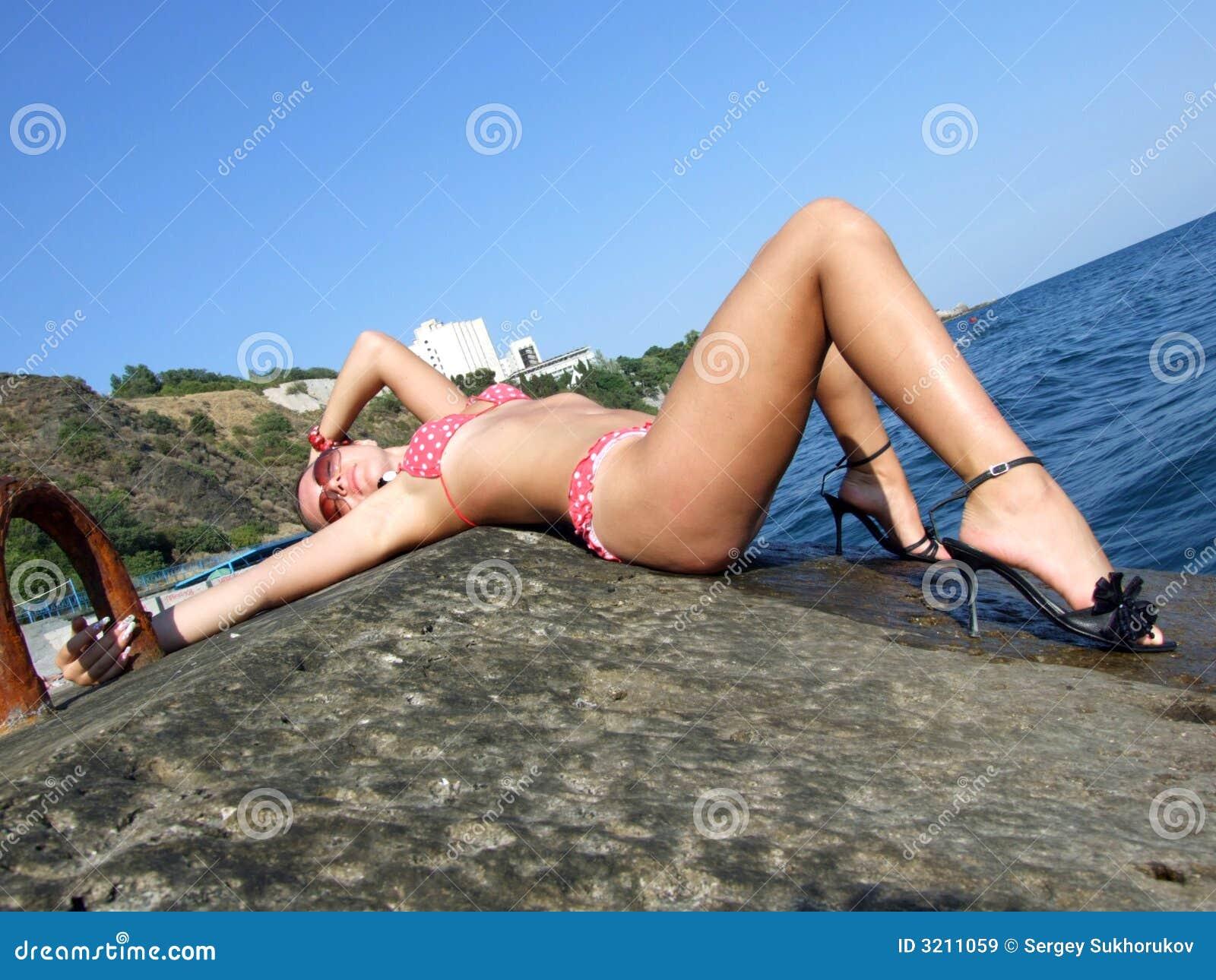 The girl lays on a wharf