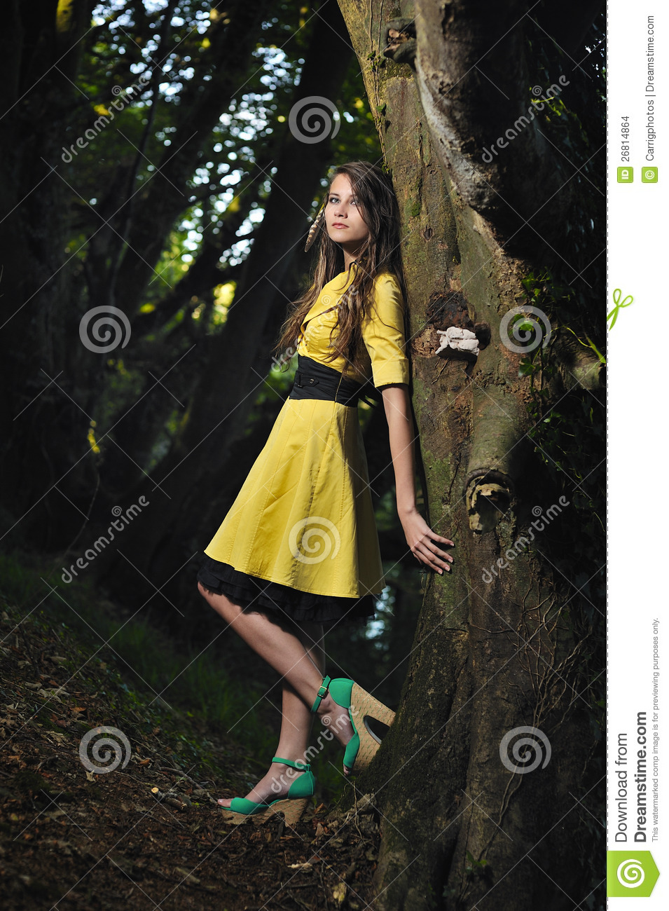 Teenage girl leaning against wall Stock Photo: 71414752