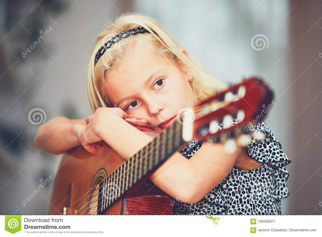 girl learning to play to the guitar stock image image of boredom childhood 100385971. Black Bedroom Furniture Sets. Home Design Ideas