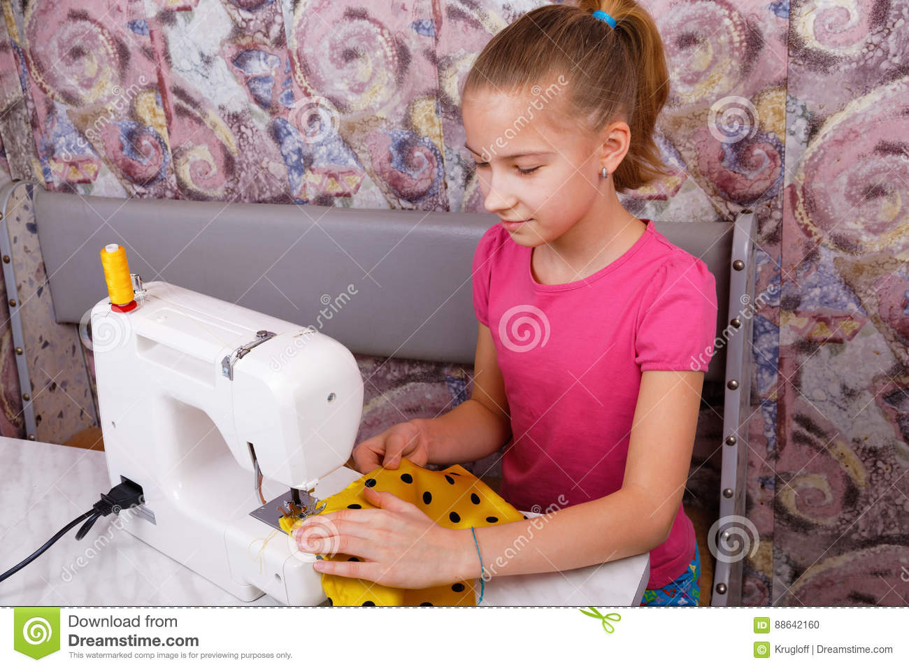 Girl learns to sew