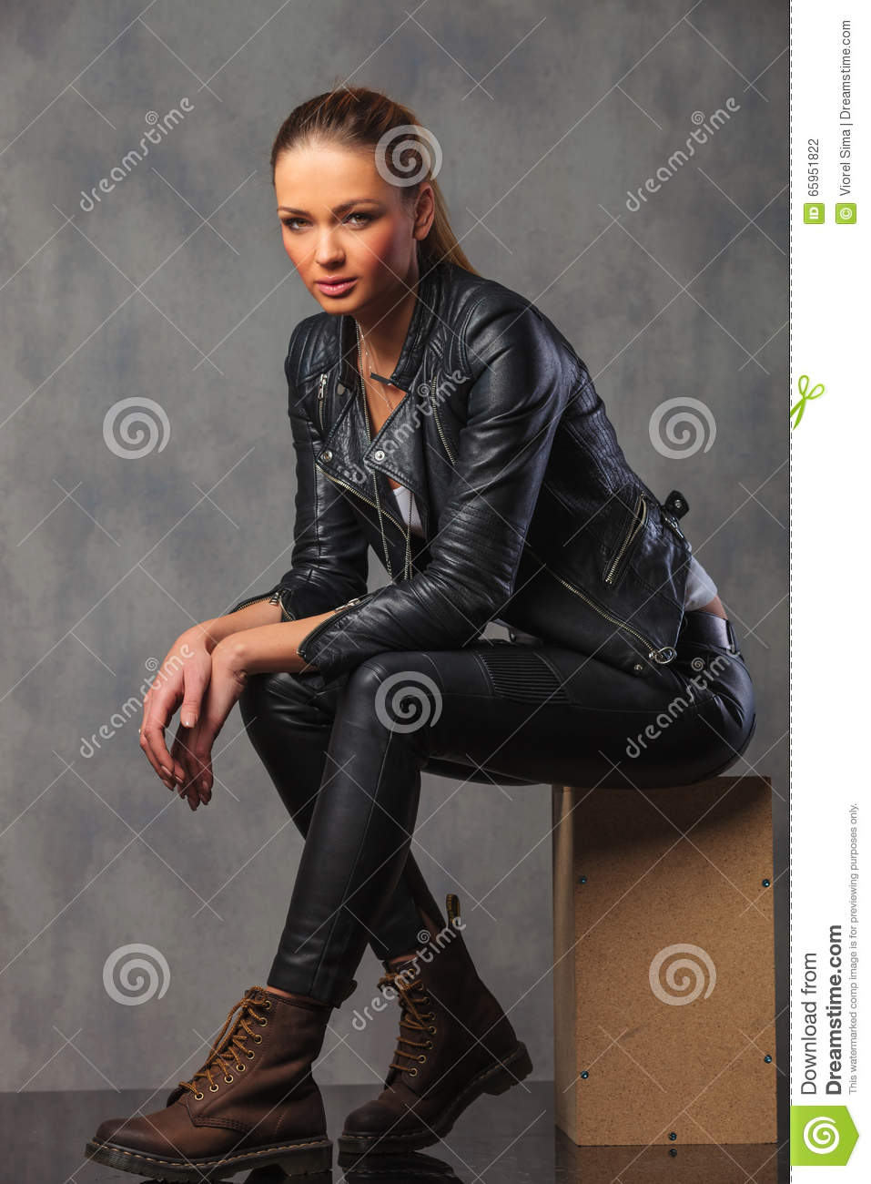 Girl In Leather Jacket Posing In Studio Seated Resting -2967