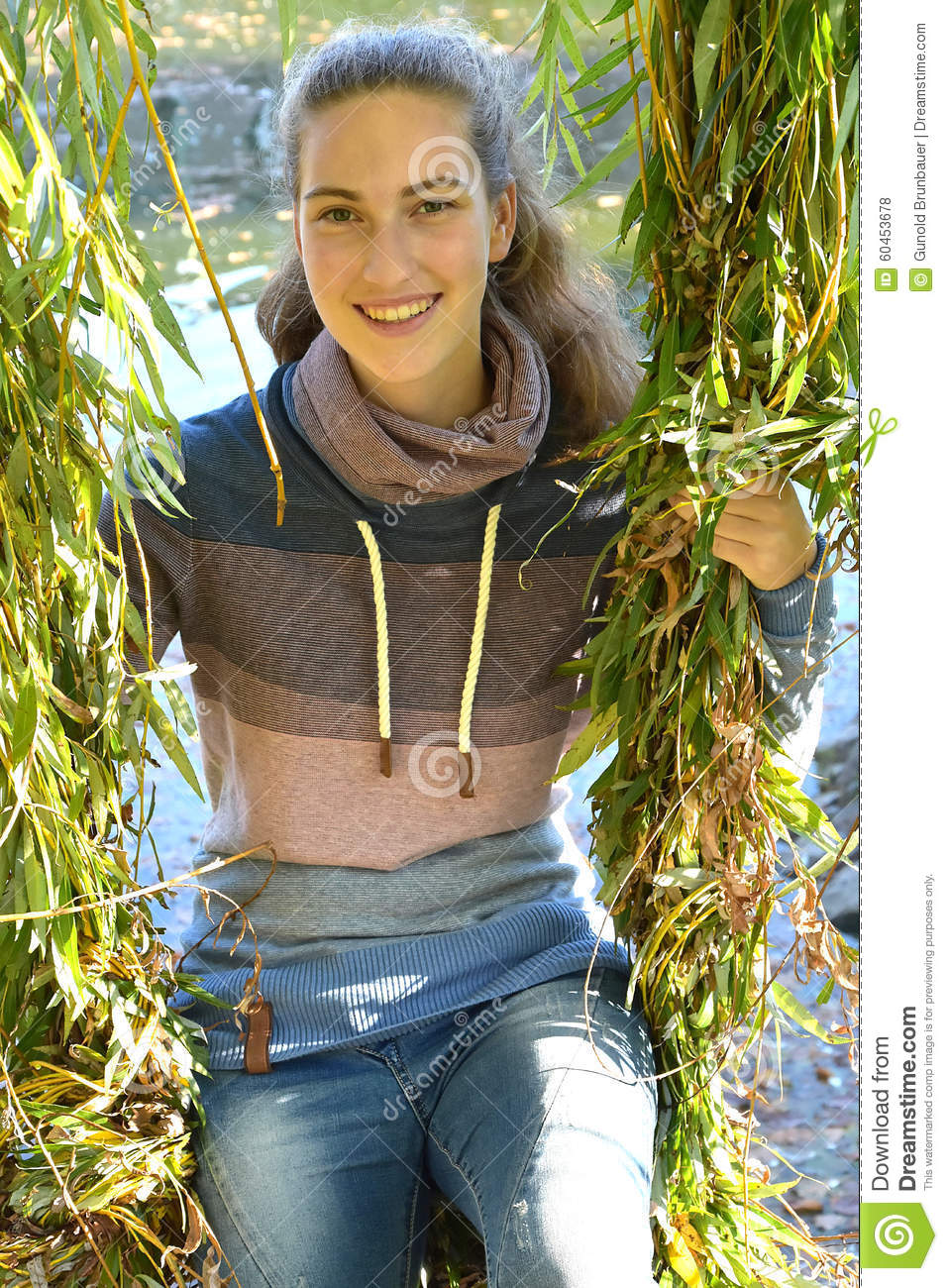 Girl in the leaves of a weeping willow
