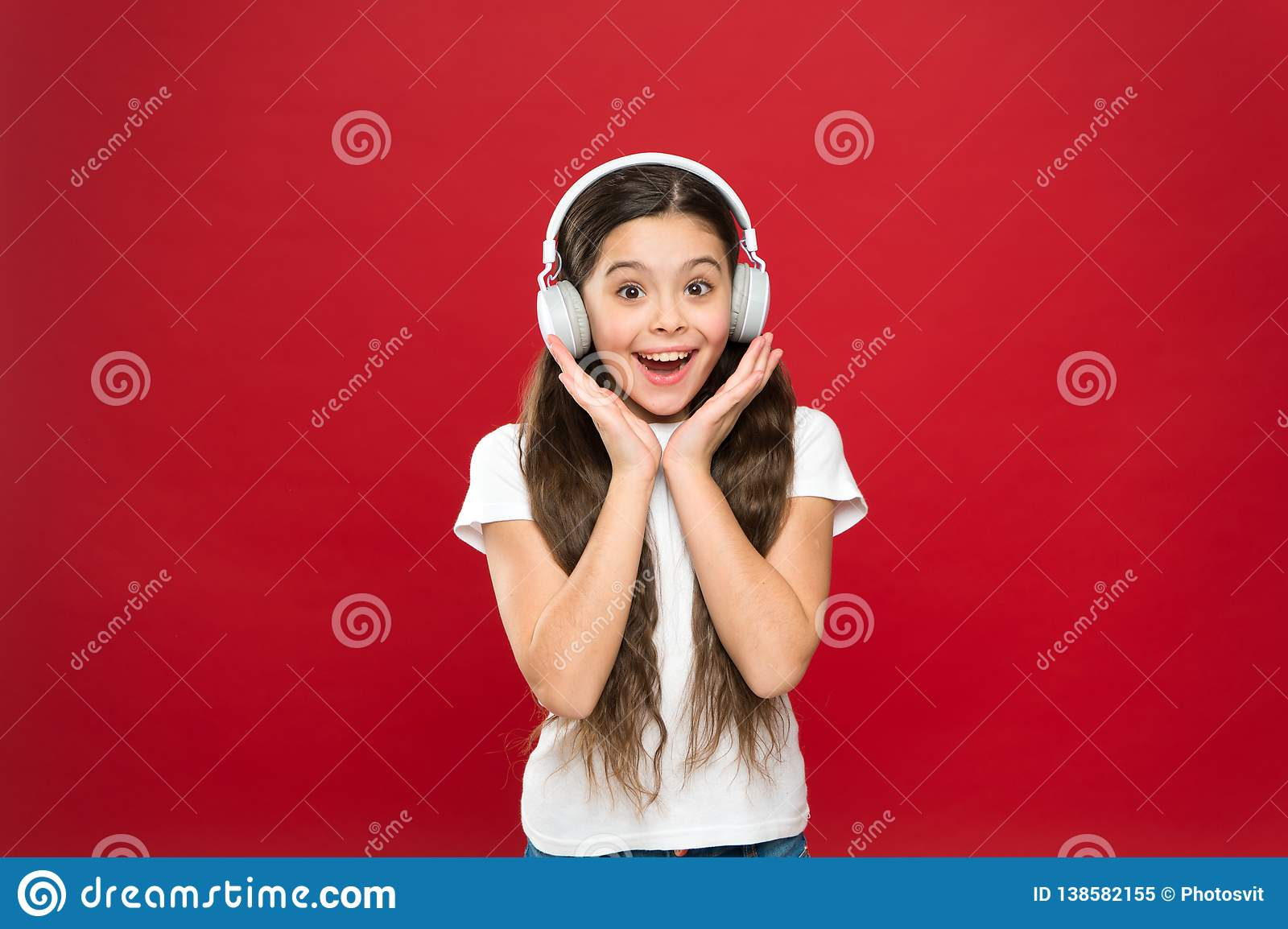 Girl listen music headphones on red background. Play list concept. Music taste. Music plays an important part lives