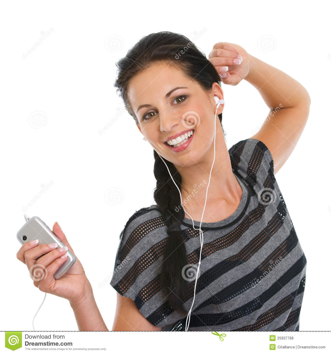 girl listening music in headphones and dancing stock photo