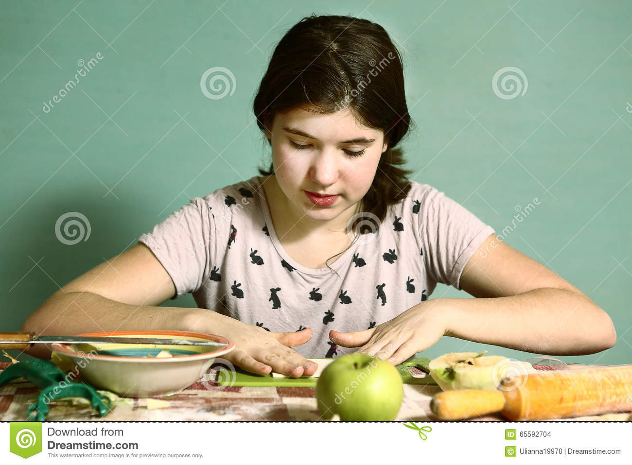 Teen Pretty Girl With Long Dark Hairs Prepare Pies With Cut Apples