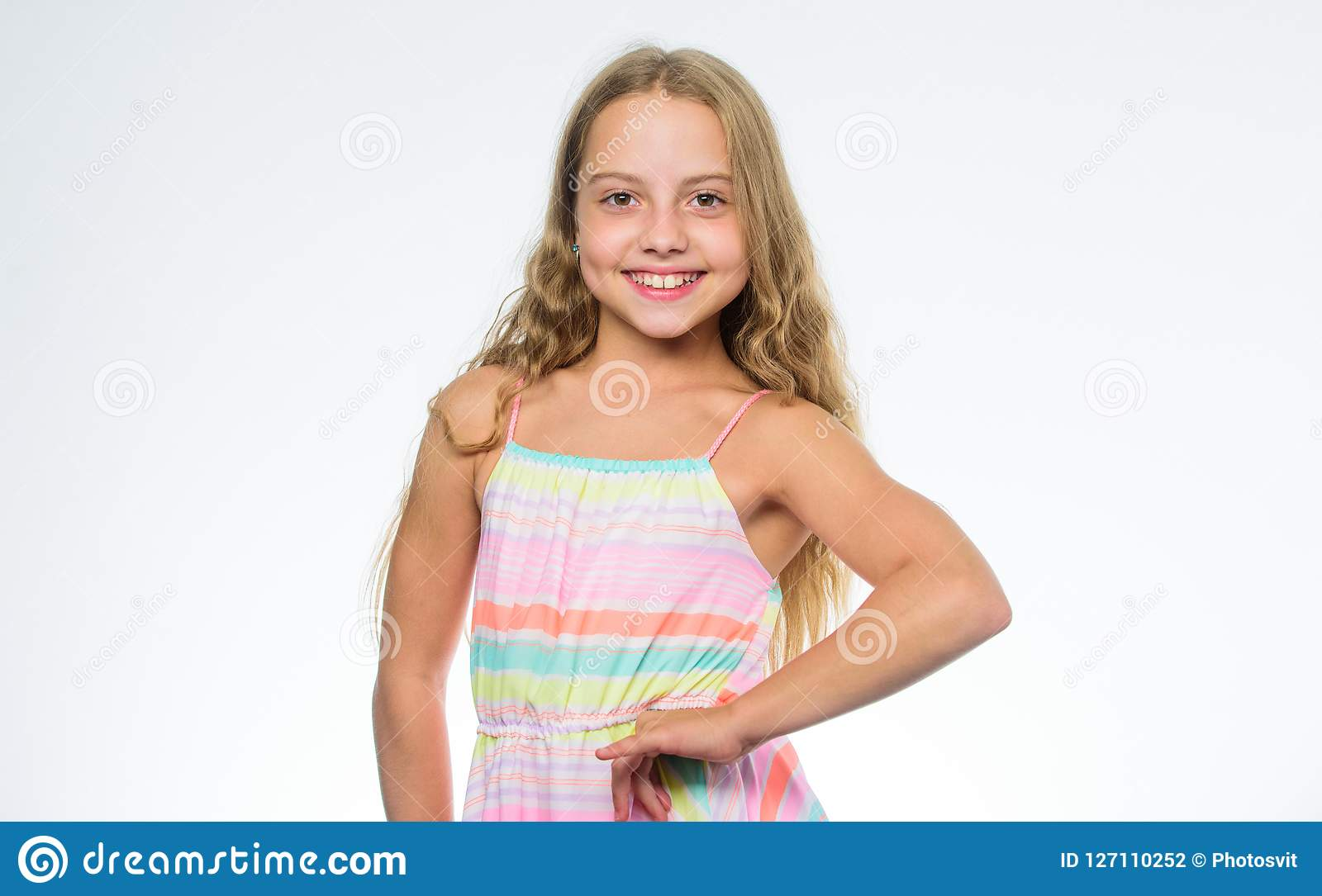 Girl long hair smiling face white background. Natural beauty. Teaching your child healthy hair care habits. Hair care