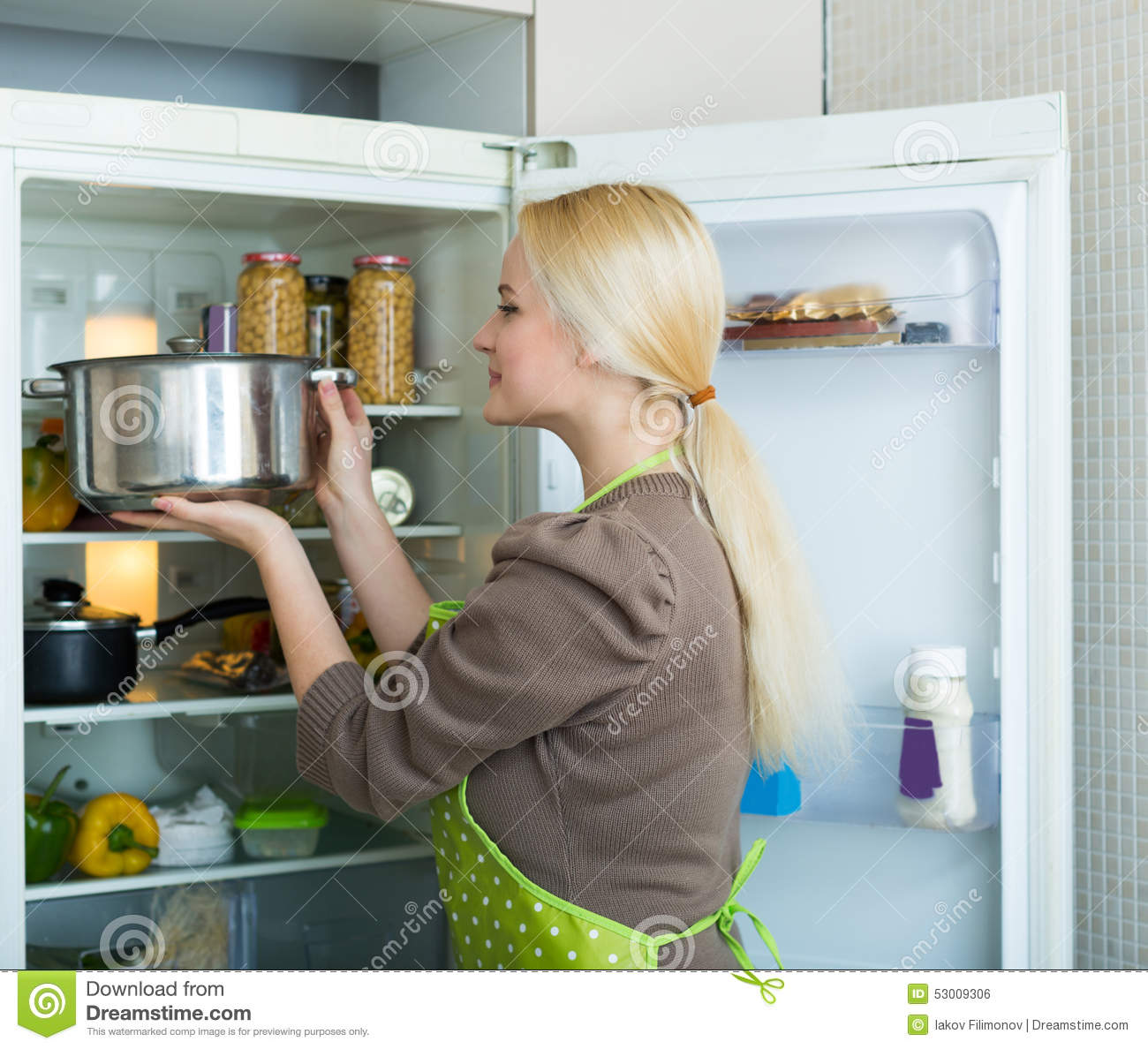 Something Blond Blue Kitchens: Girl Looking For Something In Fridge Stock Photo