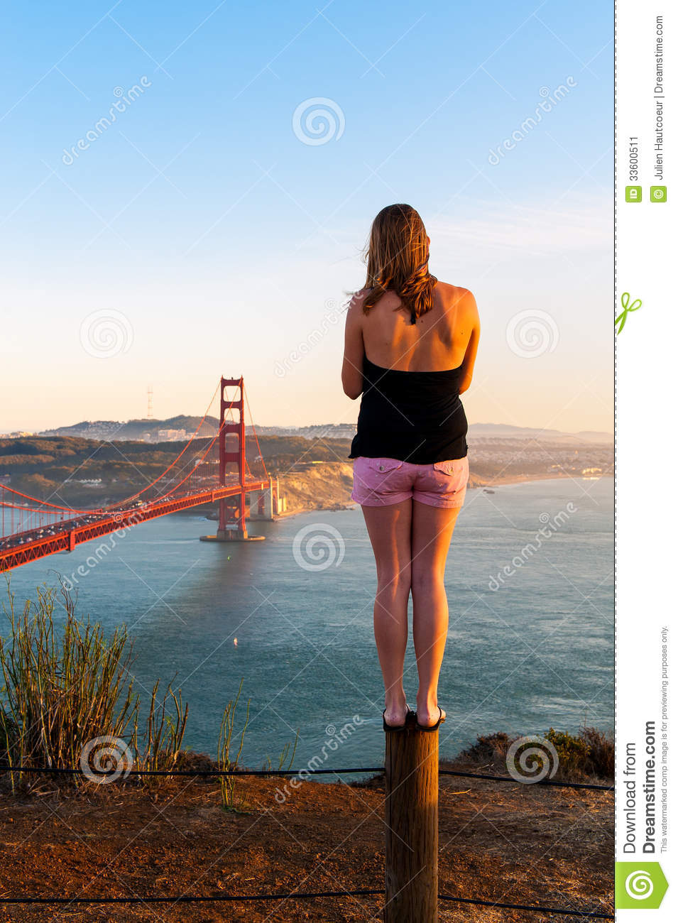 A Girl Looks At The Golden Gate Bridge In San Francisco