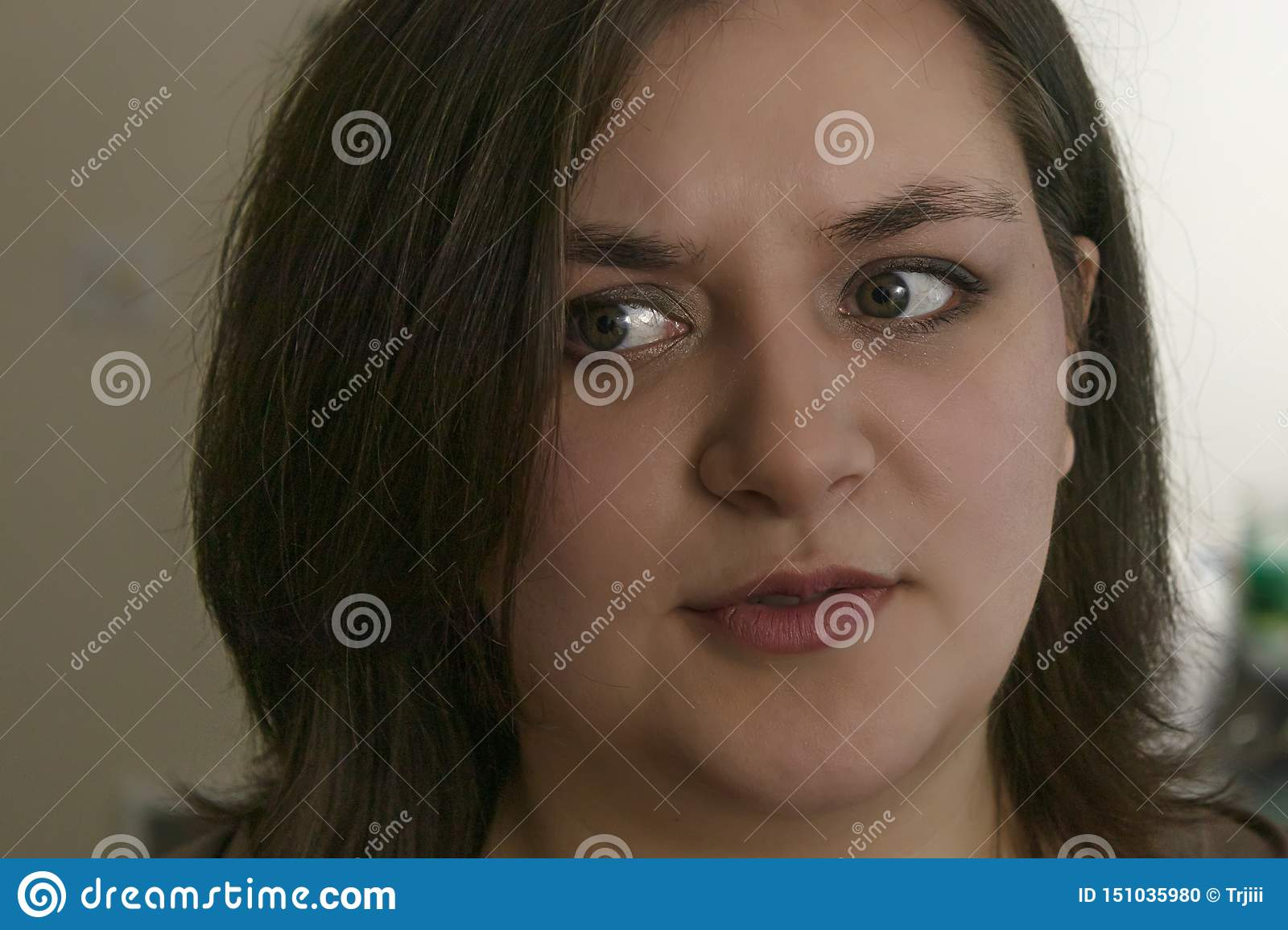Girl looks of to the side questioningly wondering about something