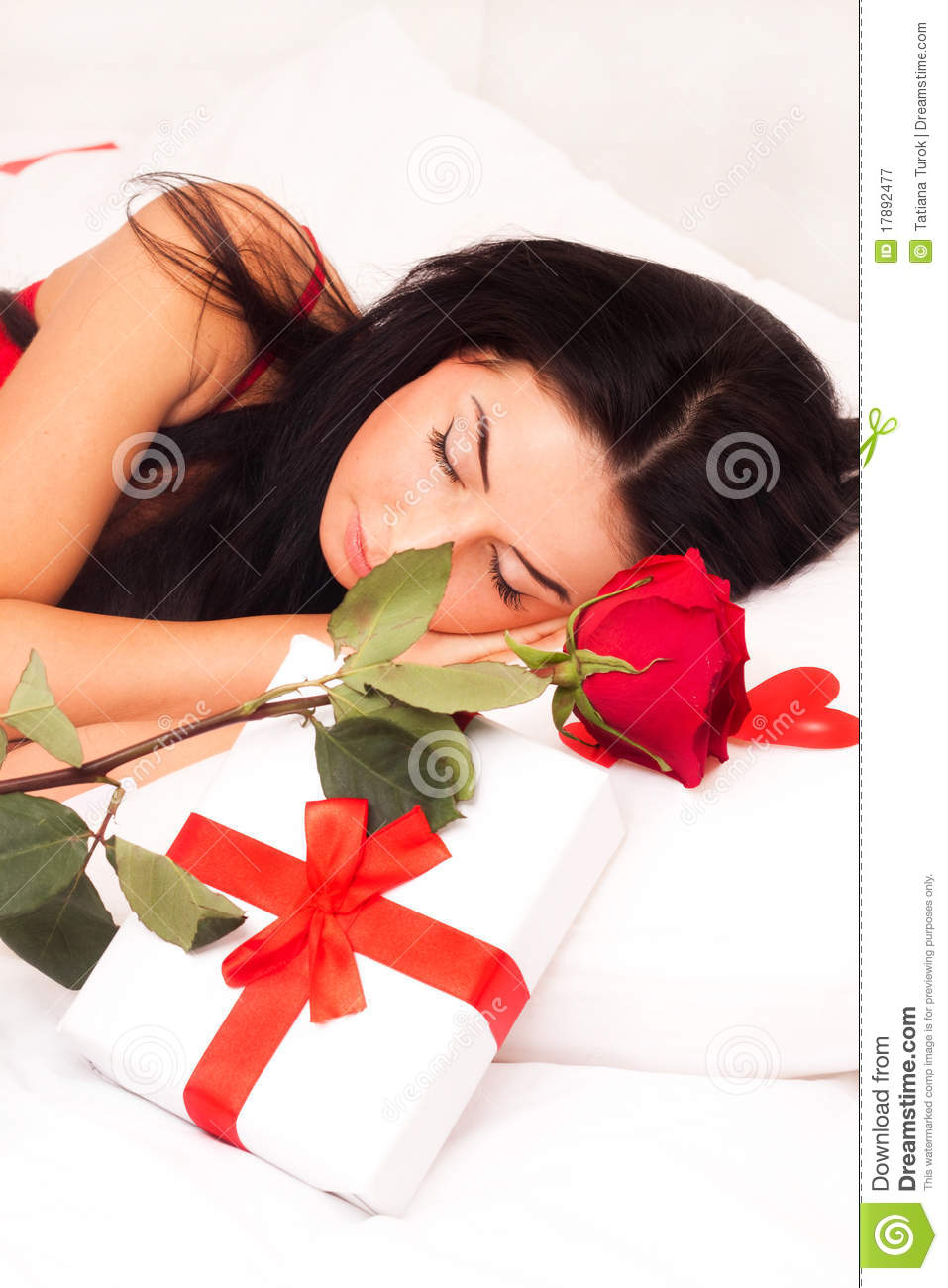Beautiful Girl Lying On A Bed Of Roses