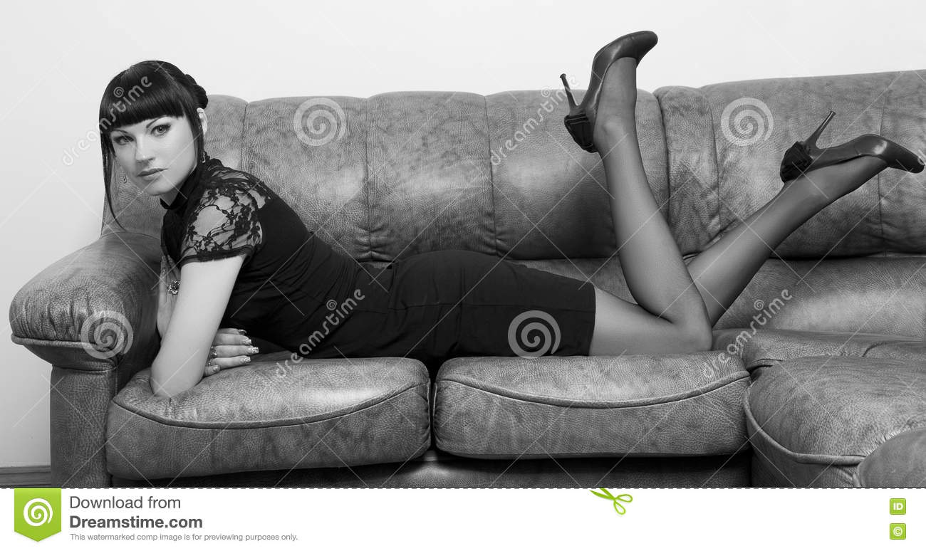 Girl lying on a couch in the Office